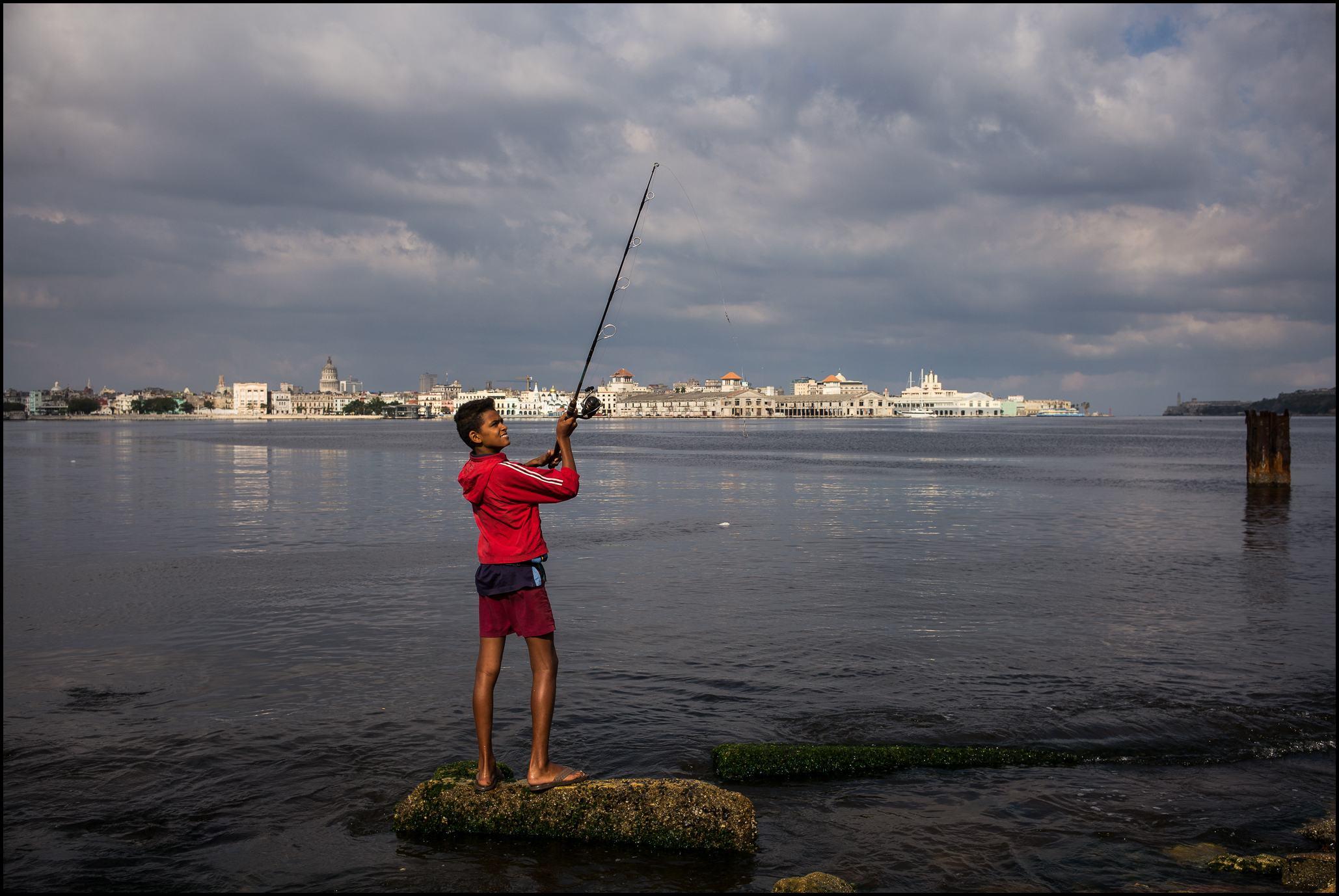 Boy Fishing, Regla