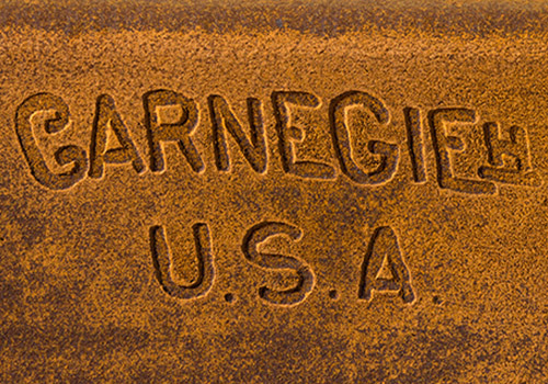 Missed branding opportunity - The stamps on our steel bear the name of Andrew Carnegie . The company awarded the bridge work was US Steel, the name JP Morgan gave it after he bought it from Carnegie. (note the