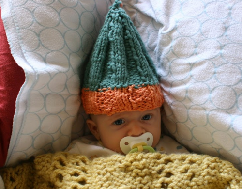 Try knitting, then knit something absurd to put on a baby. Then take a photo and never use it again. Just remember, after the absurd knits comes the cool stuff you actually use over and over again.