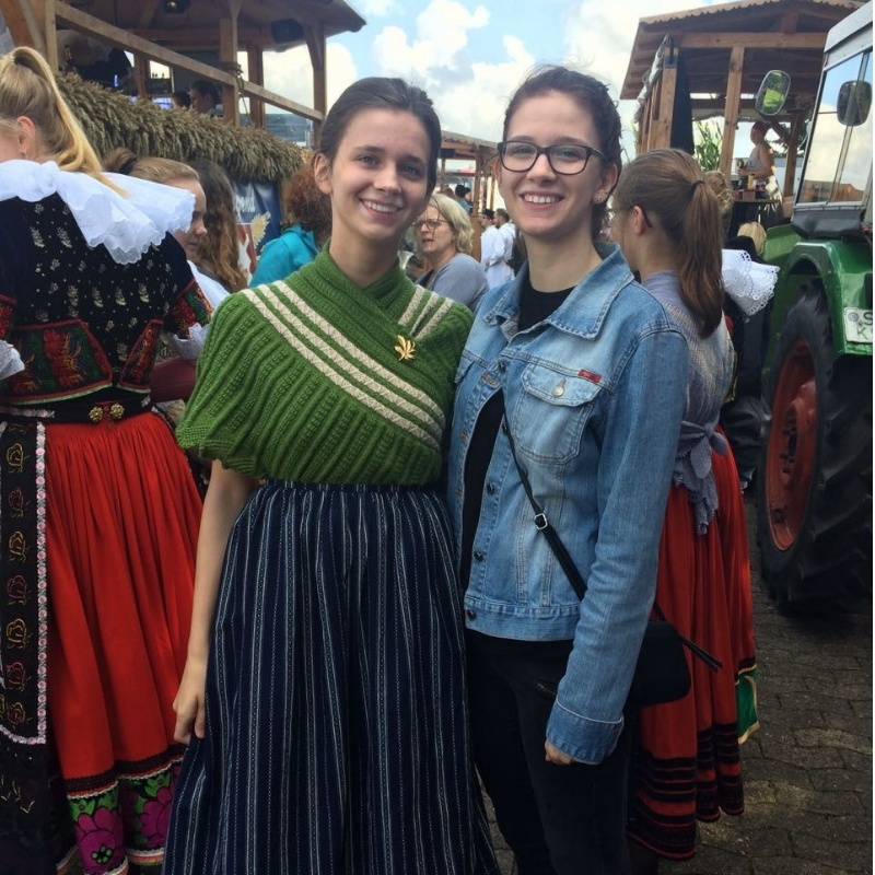 """Isabell with her sister at the """"Erntefest"""" in her hometown."""