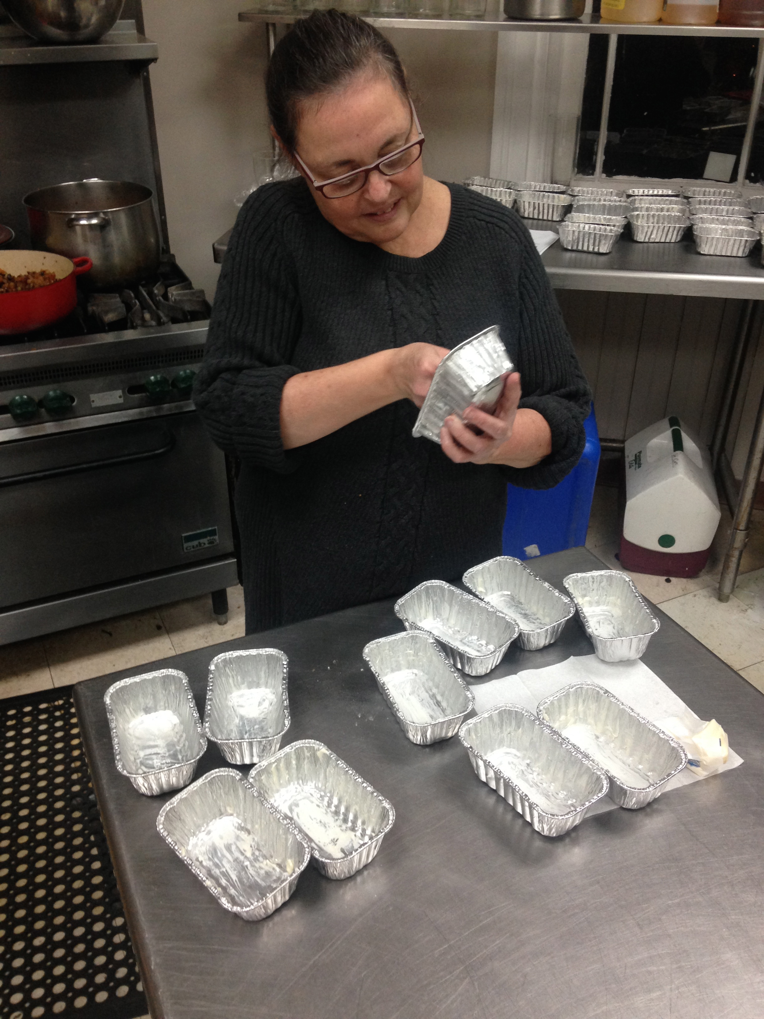 Nancy made sure the pans were plenty buttered and ready to go.