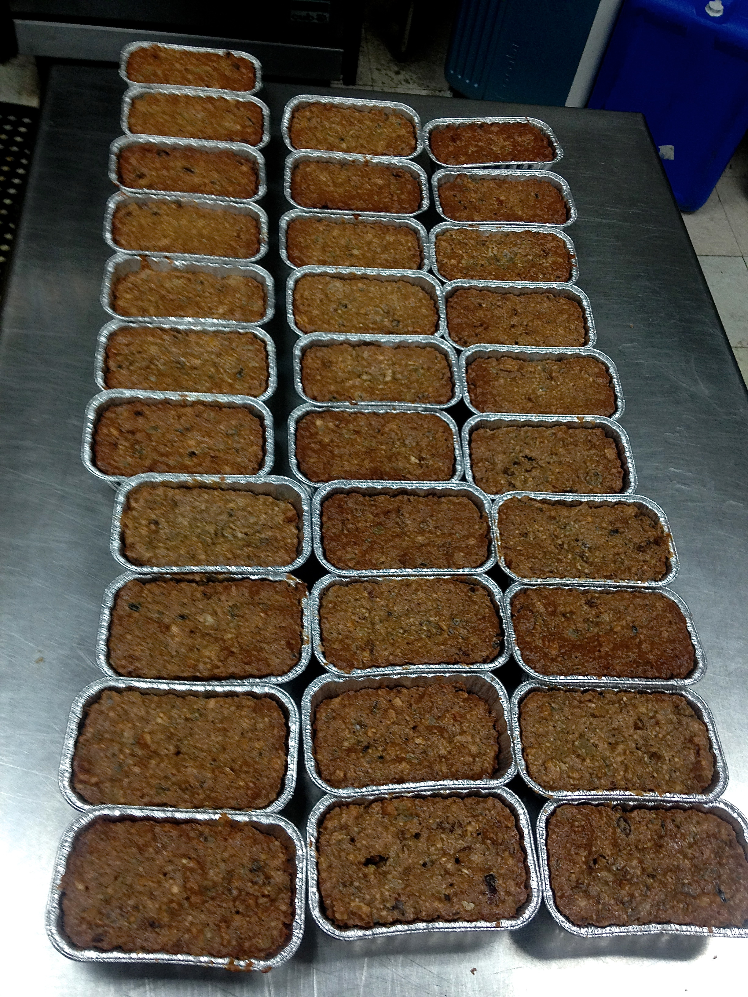 We finished reading the story in the library as the room filled with a heavenly aroma...31 fruitcakes ready to be steeped in booze...