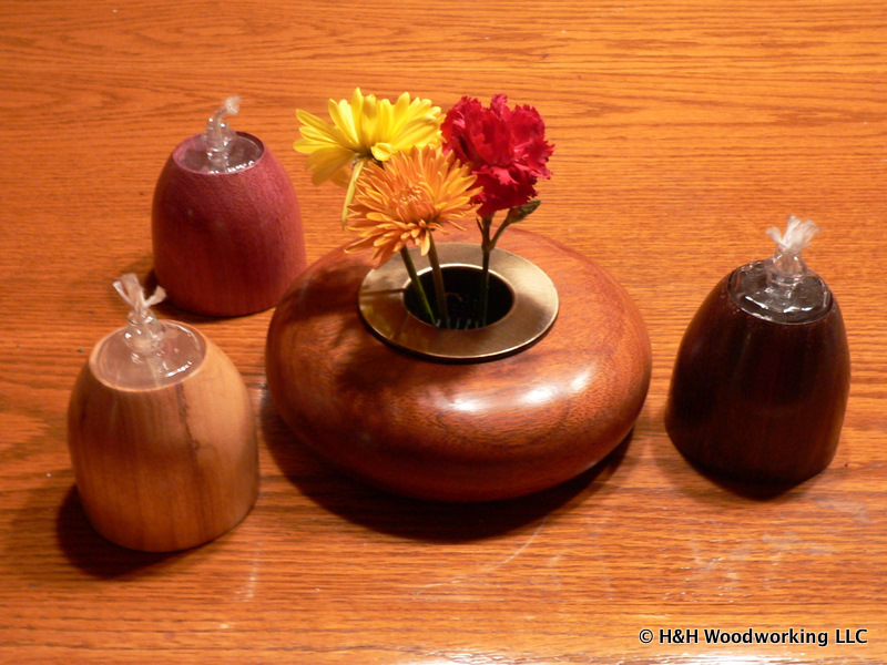 Turned vase and oil lamps