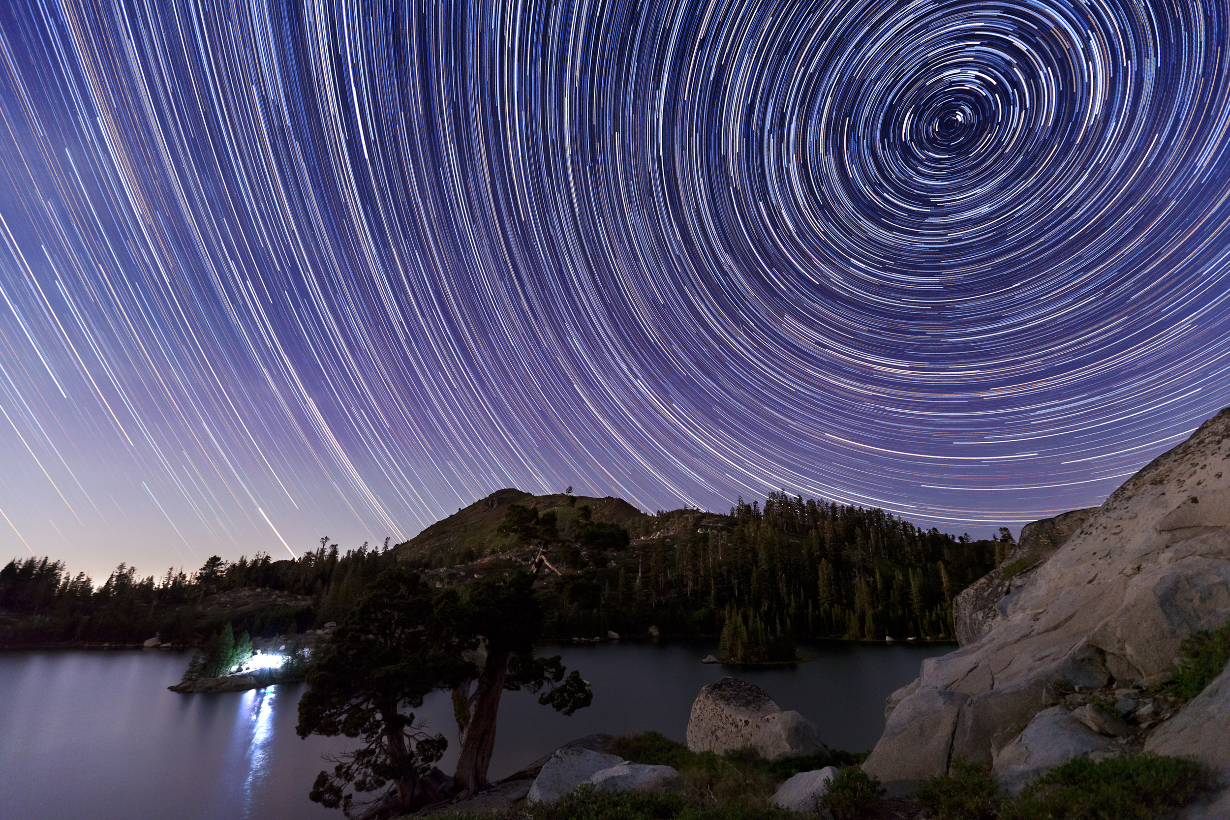Star trails above Grouse Lake under moonlight