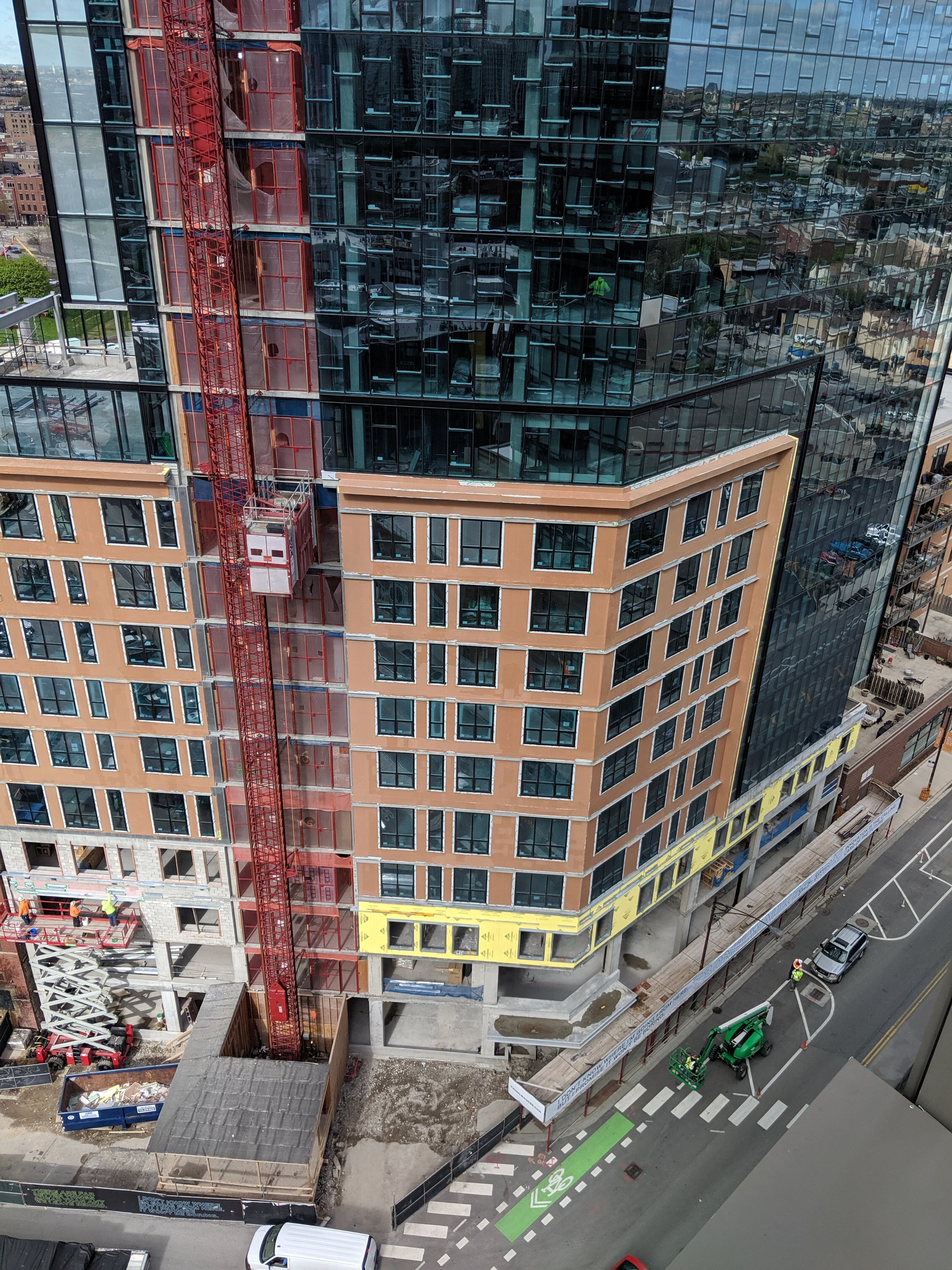 Glass curtain wall being installed at 730 N Milwaukee