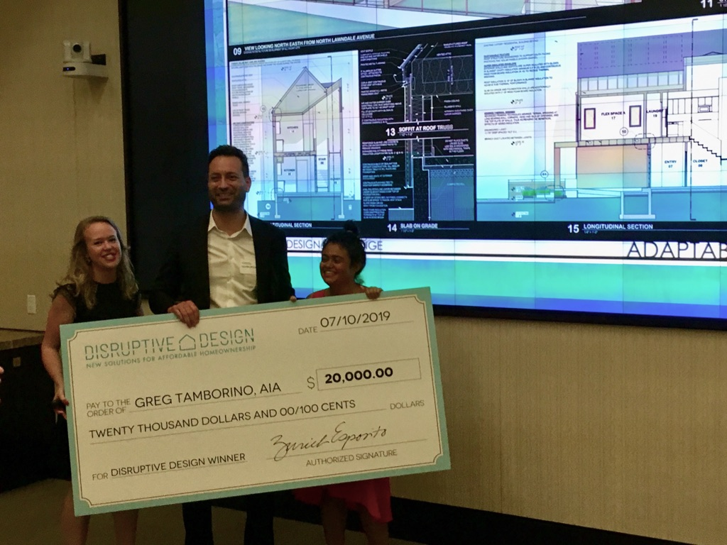Brune, Tamborino, and Rao holding a giant check.