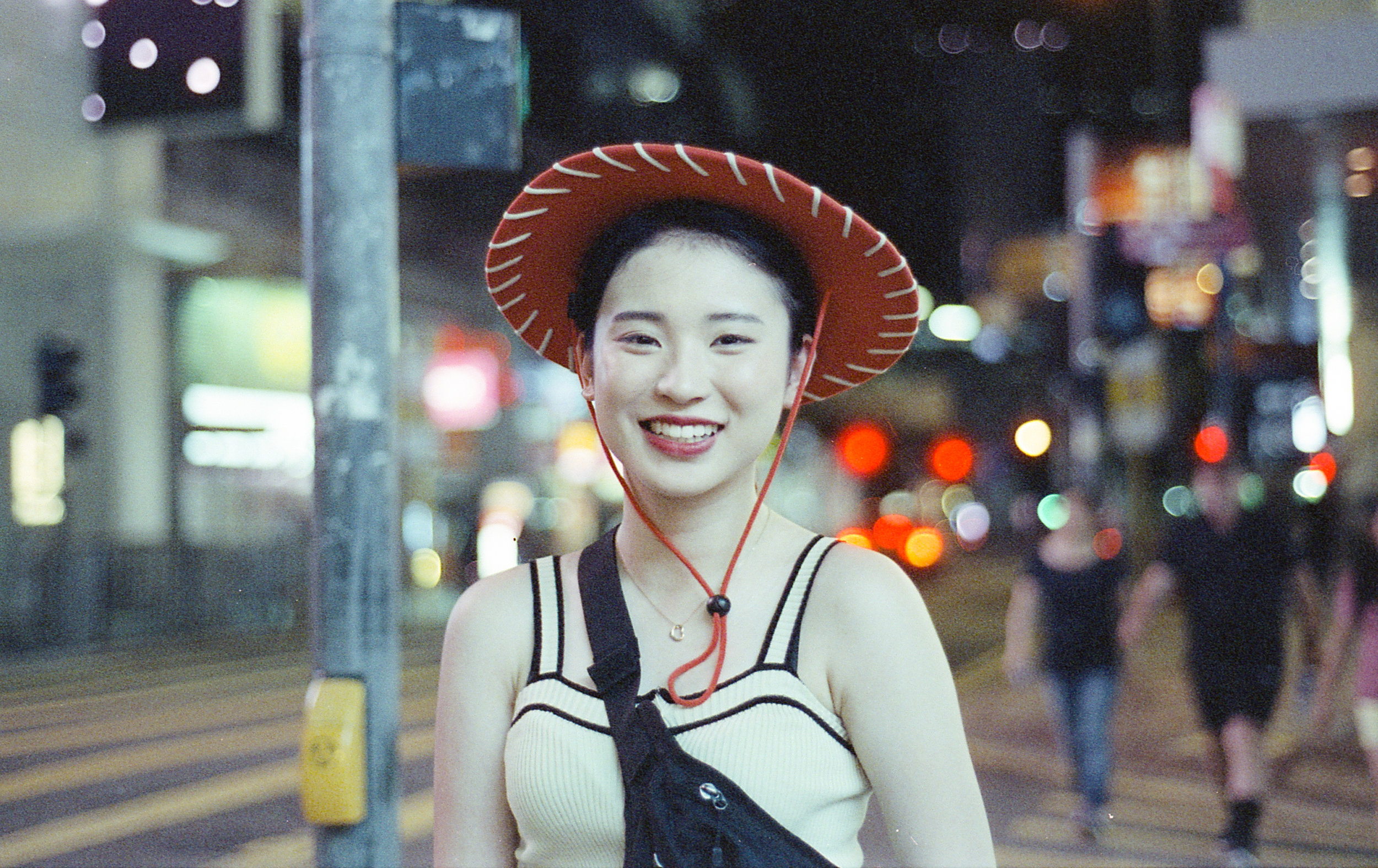 Shot on Cinestill 800T in Hong Kong. (I should have gotten her contact info... I am heart broken and dumb.)