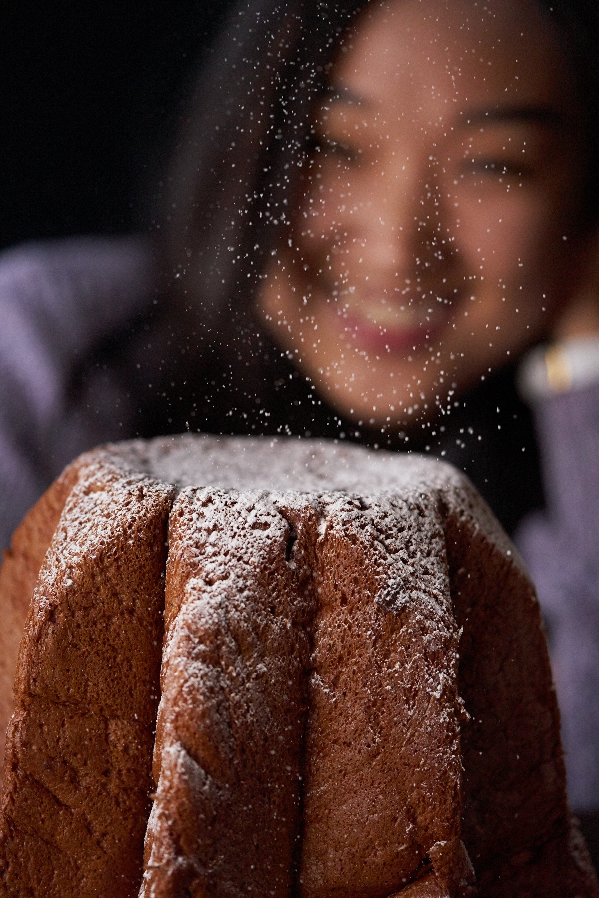 Our Digital Retoucher, Sasha, indulges in the Italian sweet bread, Pandoro. The treat is dusted with powdered sugar, which made us wish for snow.