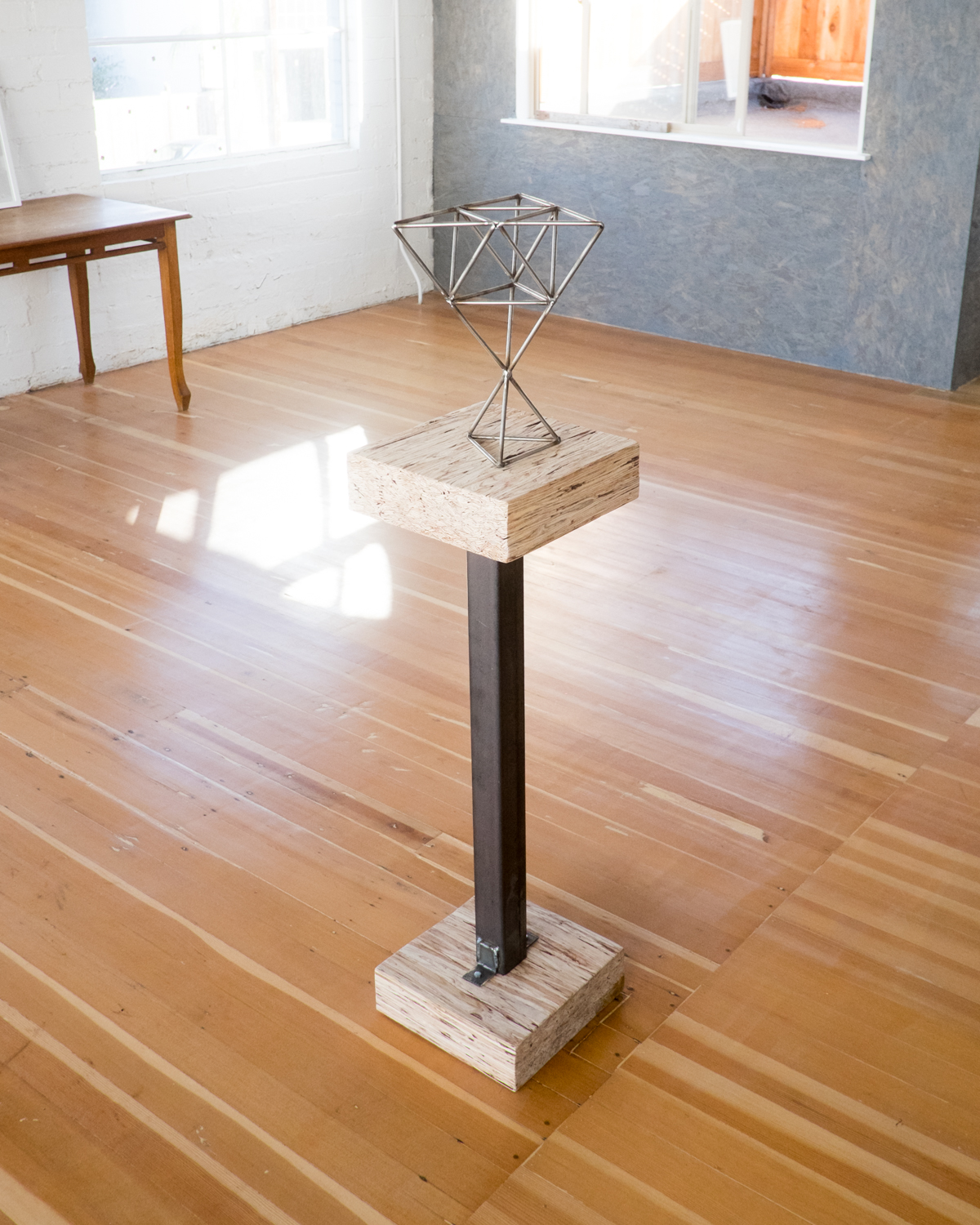 Metal work and pedestal by Cody