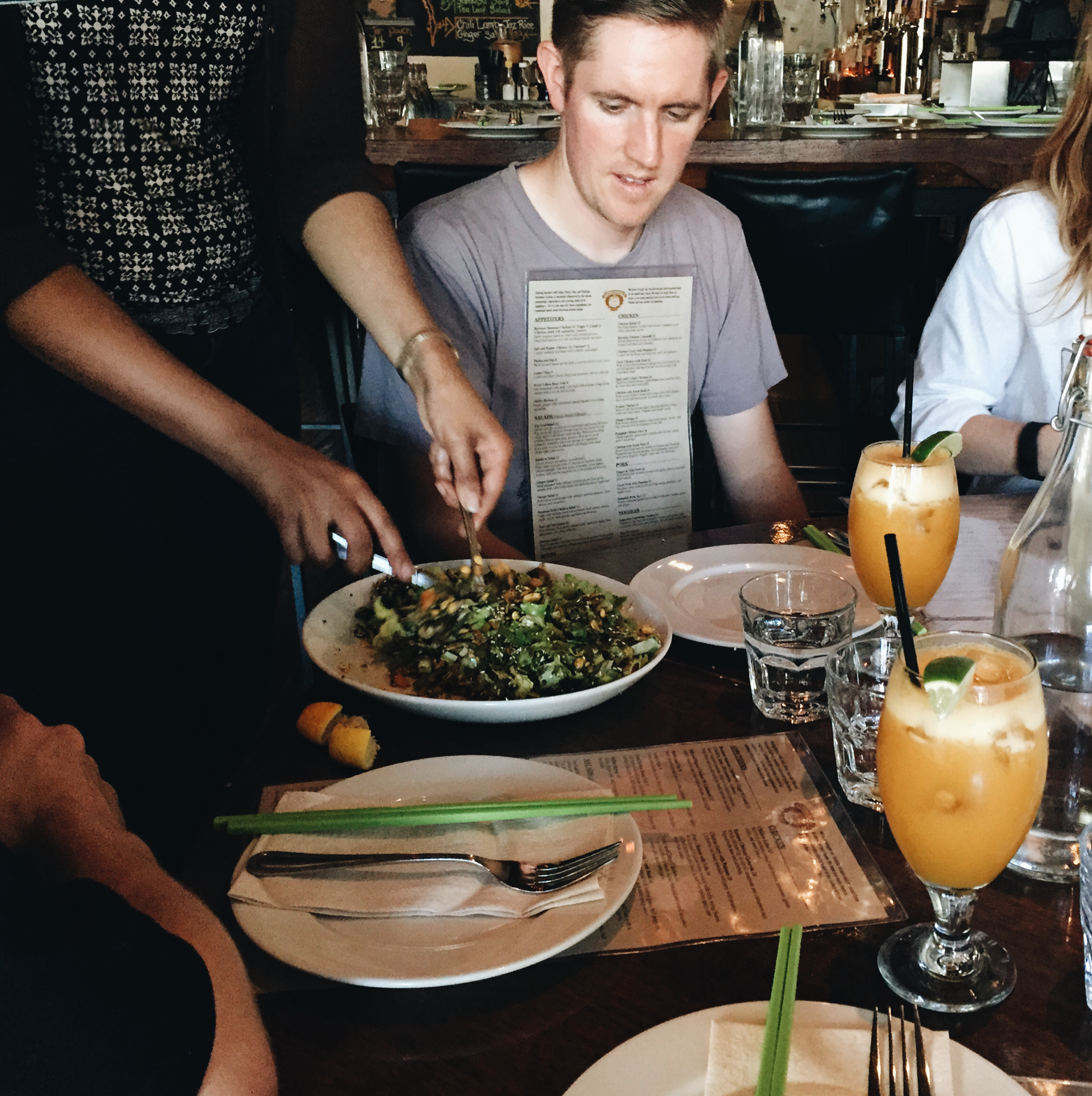 The tea leaf salad is hand mixed tableside. Photo by Dana.
