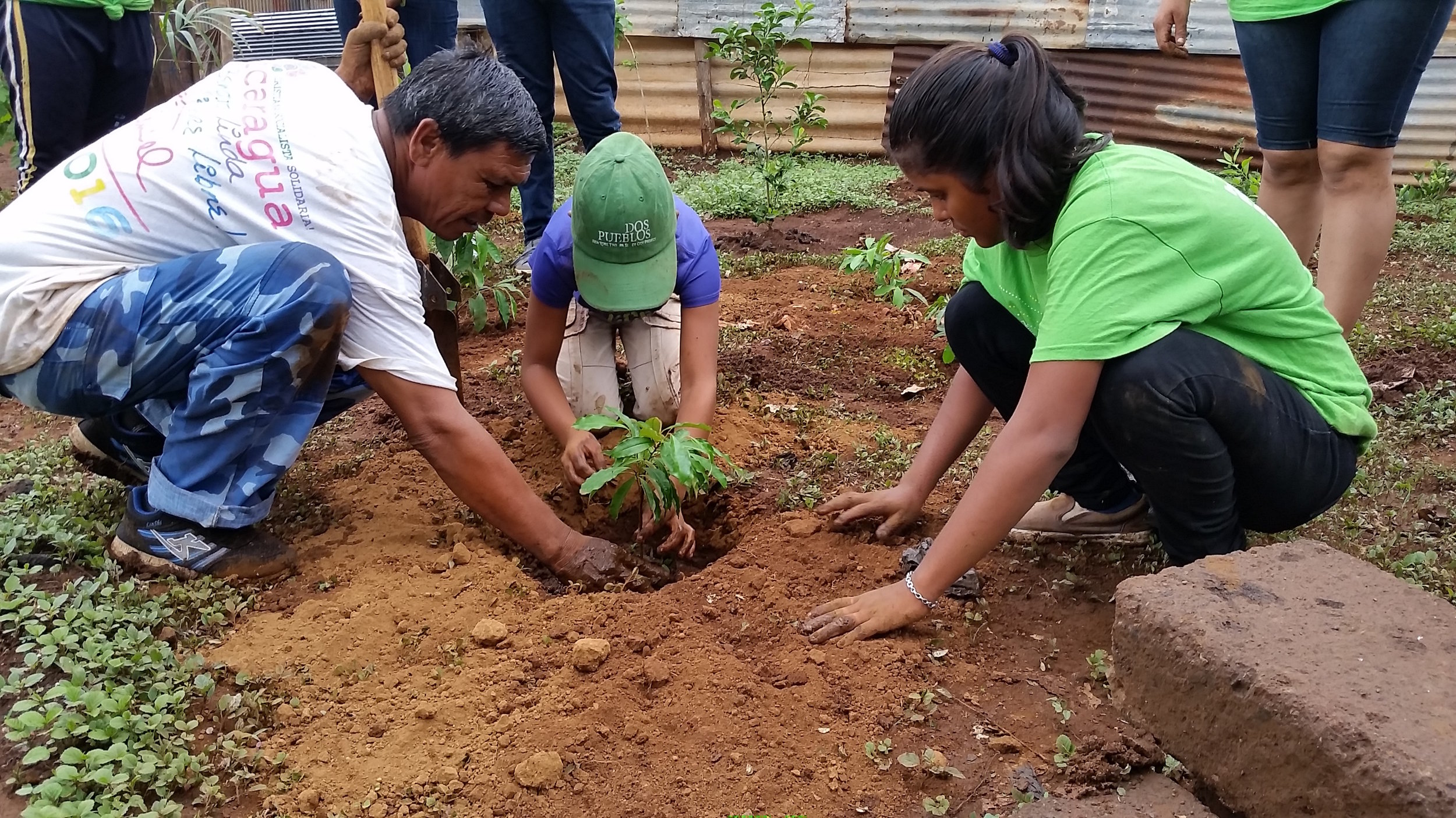 Joselyn (right) helps oversee Zoe's reforestation project in Marvin Salazar.