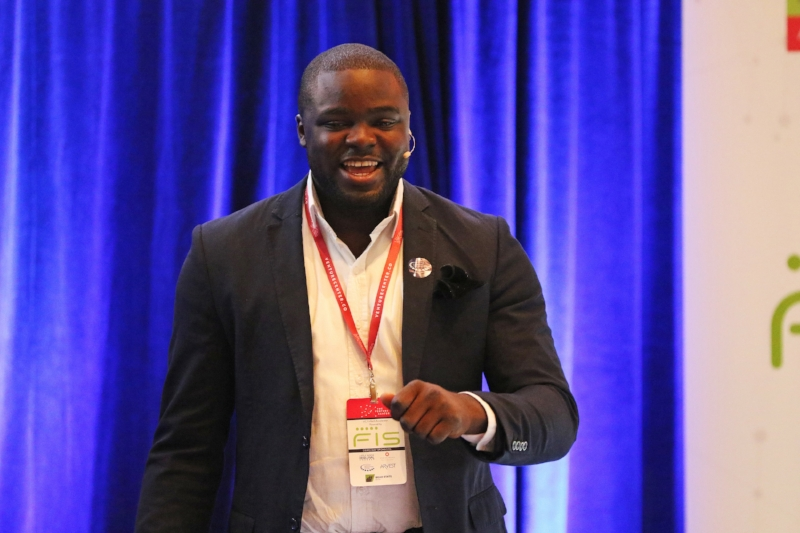 """Iyinoluwa """"E"""" Aboyeji presents Flutterwave to a room full of investors and community leaders at the 2016 VC FinTech Accelerator - Empowered by FIS."""