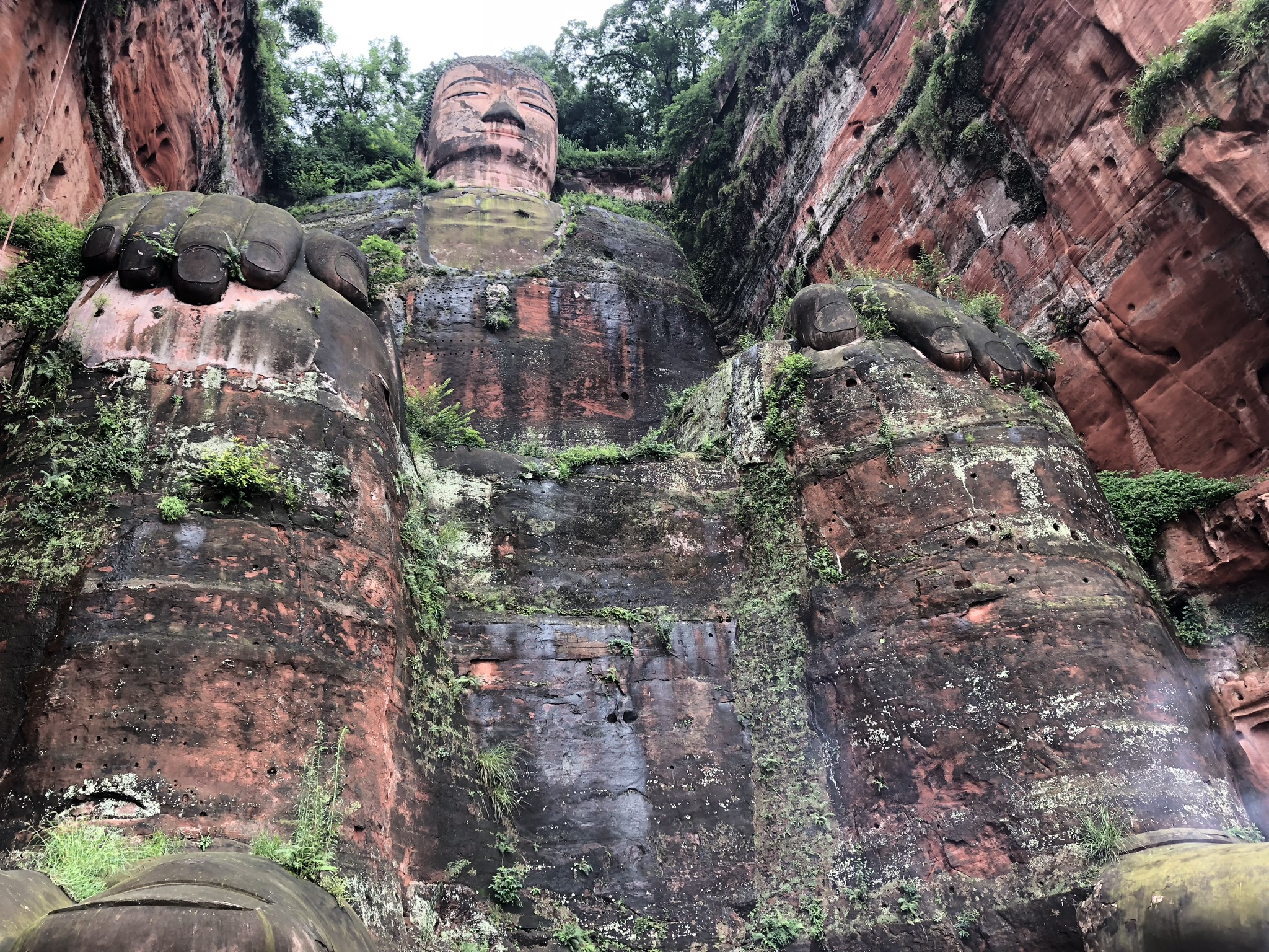 Leshan Giant Buddha - This statue is enormous! The line to see the Buddha can be long, but it's worth the wait. Tip: Be on the lookout for monks wearing robes and sandals...and playing with their smartphones.