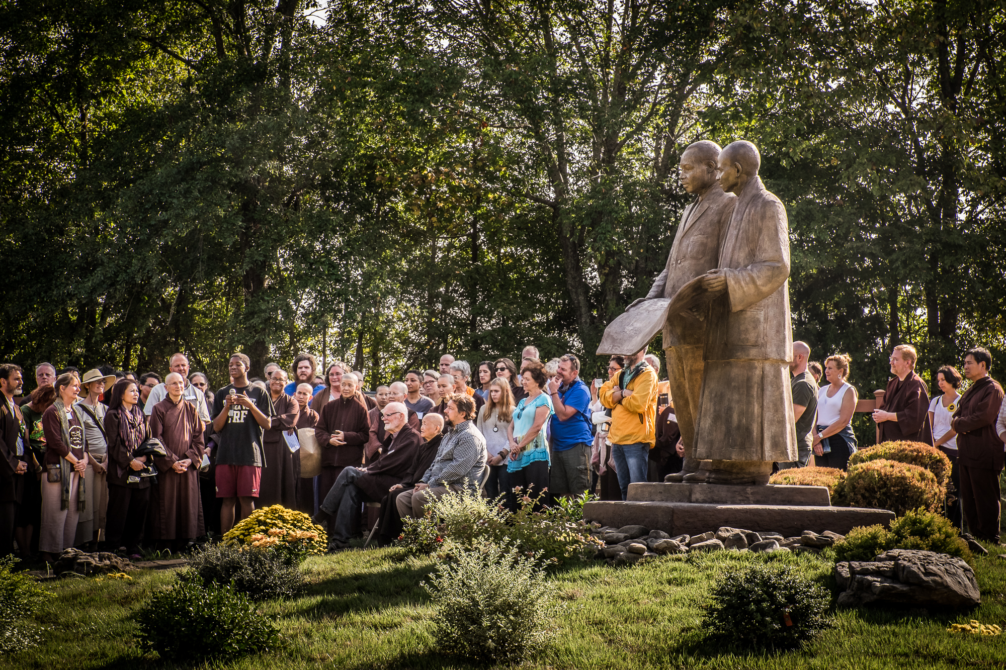Dedication ceremony for the sculpture of Thich Nhat Hanh and Dr. Martin Luther King Jr. at Magnolia Grove Monastery. Photo by Paul Davis