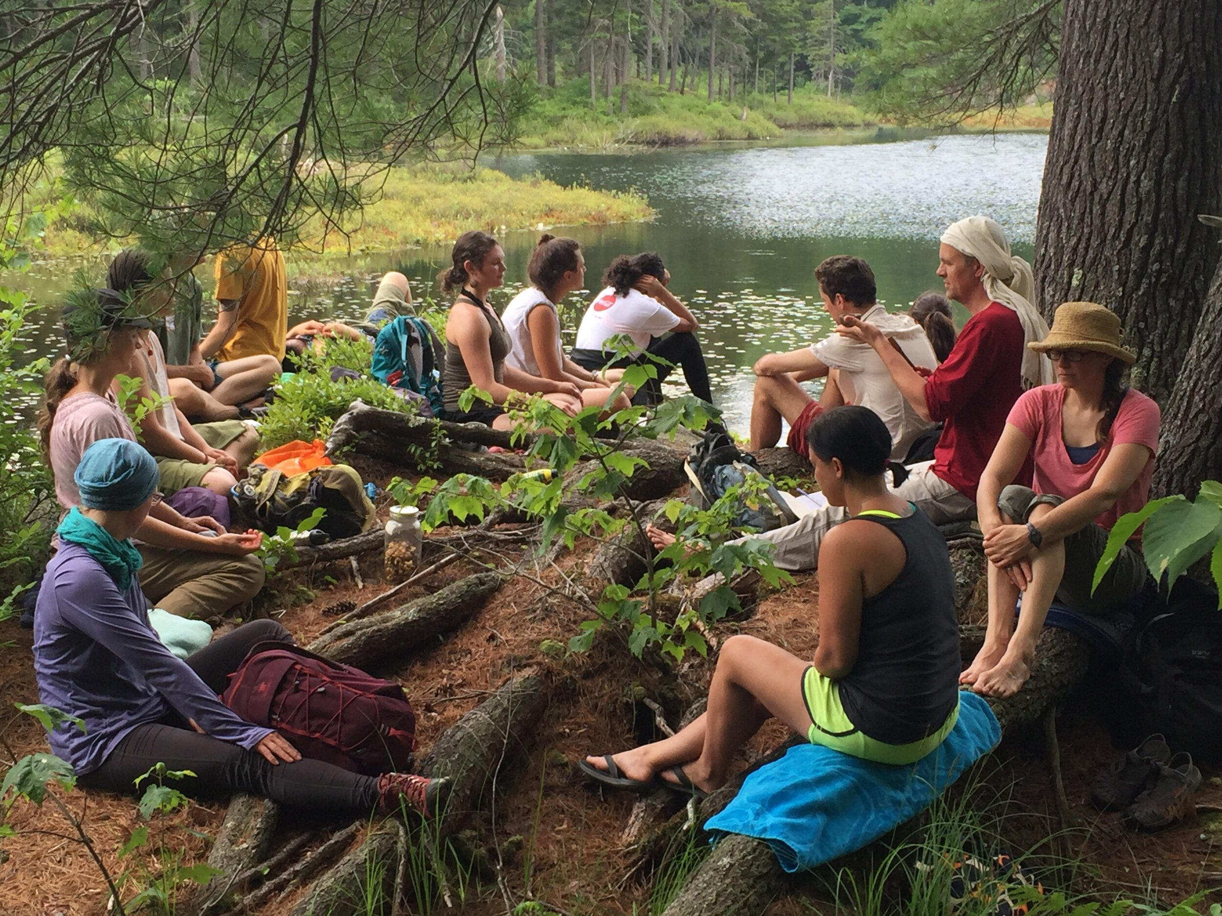 Practicing sitting meditation during a group hike.