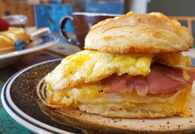 Happy Sunday friends!  Spend the last of the holiday weekend with us for breakfast! Today we have our fresh Belgian waffle and our new spin on the Canal Classic!  Fresh housemade biscuit baked with cheddar cheese inside with a fried egg, thick sliced ham, cheddar cheese, and topped with old bay seasoning. #freshfood #coffeeshop #coffee