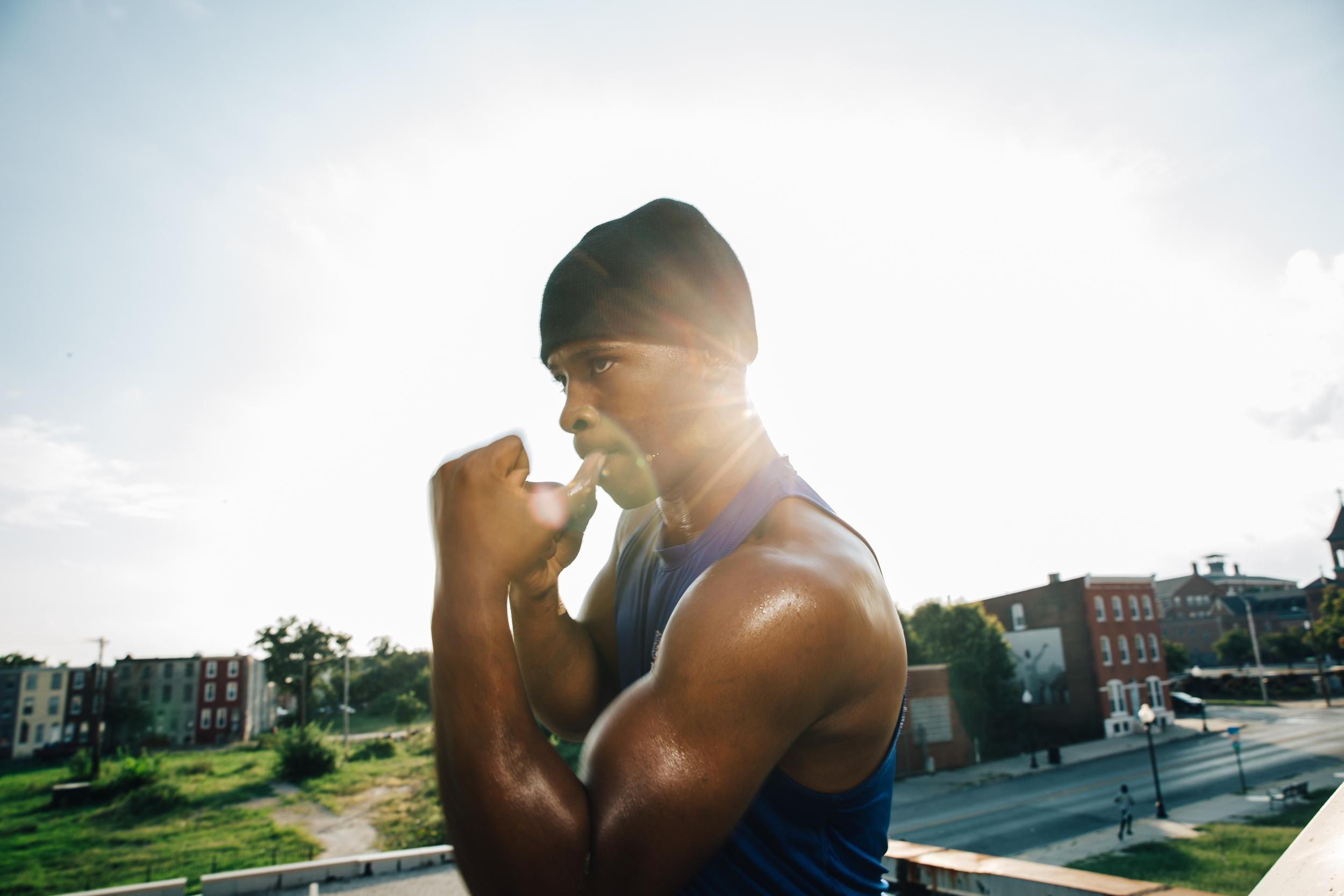 "Aug 31, 2016; Baltimore, MD, USA; Upton Boxing Center team member Lorenzo ""Truck"" Simpson poses for a portrait on the roof overlooking West Baltimore.Credit:@ebrianschneider - Instagram@brian_schneider - twitter@ebrianschneider - Facebook"