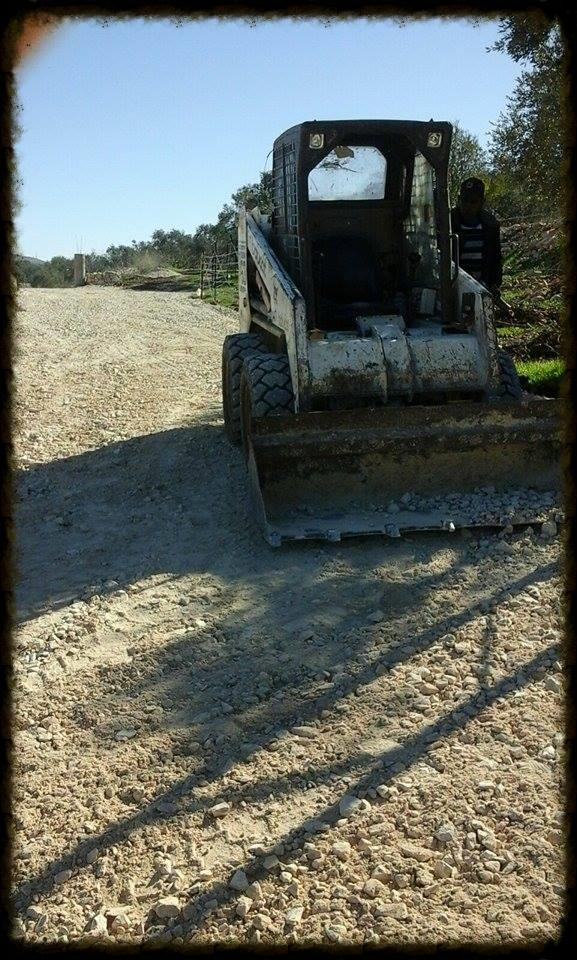 Bulldozer Leveling the Gravel