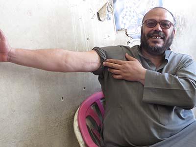 Tulkarem Exec director with bullet holes.jpg