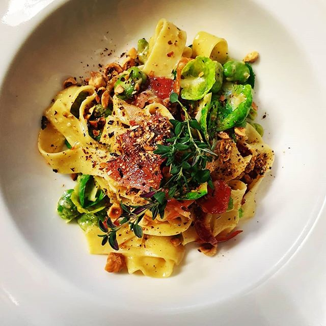 Crispy prosciutto and broadbean pappardelle pasta, sprout leaves, roasted Tasmanian hazelnuts and thyme. Book a table on 6334 5589 to taste our new Spring pasta dish.