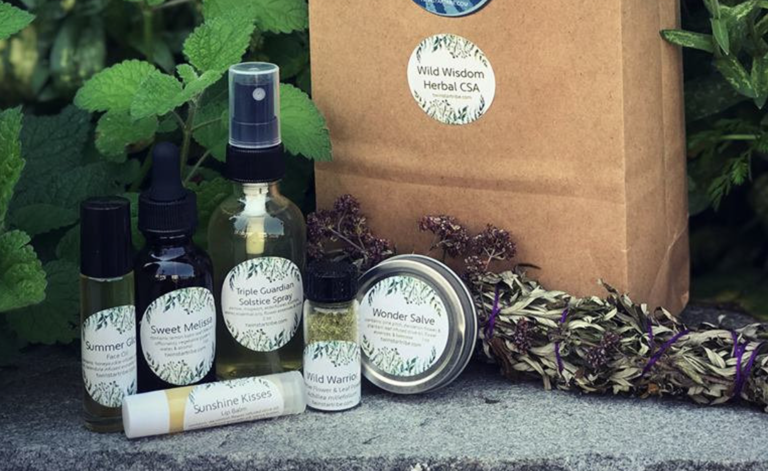 Summer Box: - Sweet Melissa (lemon balm) glycerite, Wild Warrior: yarrow powder, Wonder Salve, Mugwort Smudge Stick, Sunshine Kisses Lip Balm, Triple Guardian Solstice Spray, and Summer Glow Face Oil! All of this comes with a beautifully written newsletter explain the traditional uses of these herbs and a little bit about the products!