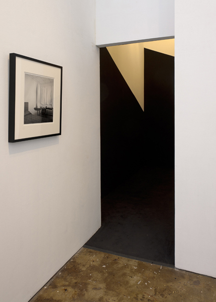 Installation view, Black Site Analogue, 1,623 Cubic Feet,  2011.carpet, paint, halogen lights.168 x 196 x 148 in.