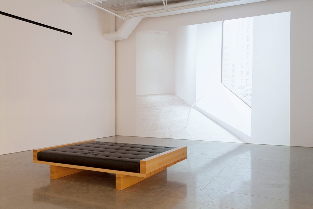 Lajkó , 2015. European steamed beech, recycled leather, foam. 18 x 60 x 88 in.  Installation view with  Marcel , 2015   Lajkó  (2015)   is a sculpture in the form of a queen-sized day bed based on a design created by Marcel Breuer for 945 Madison Avenue, formerly the Whitney Museum of American art, currently the Met Breuer. It is a sculpture in an edition of 5 with 2 artist proofs. Each piece in the edition can be customized and is intended to be used as a piece of furniture.