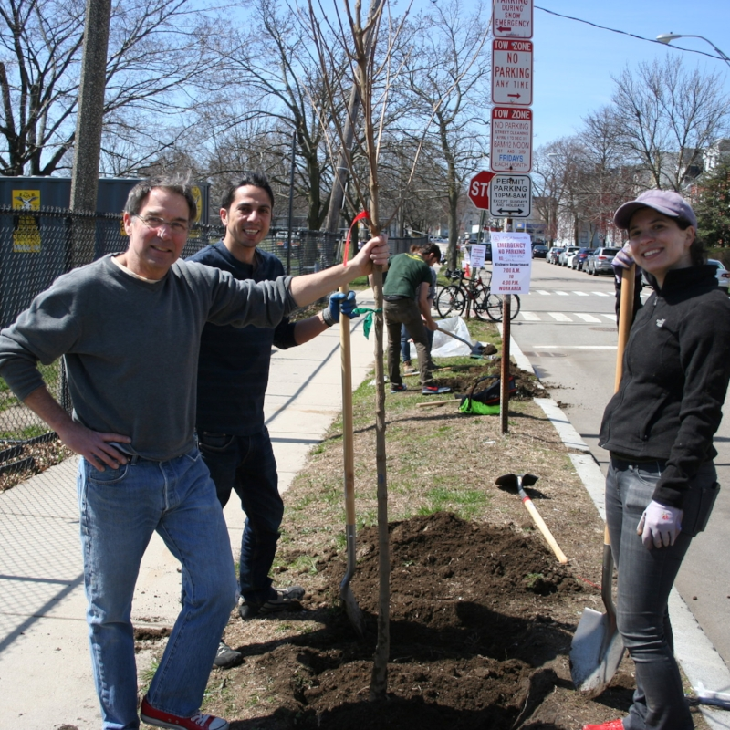 Mauricio, Paul, and Nicole stand proudly with their tree!