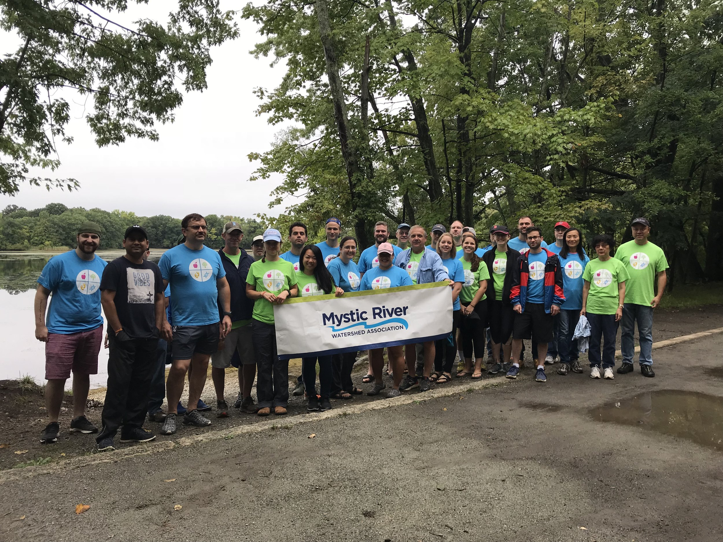 Volunteers from Perkin Elmer helped remove water chestnuts in 2018.