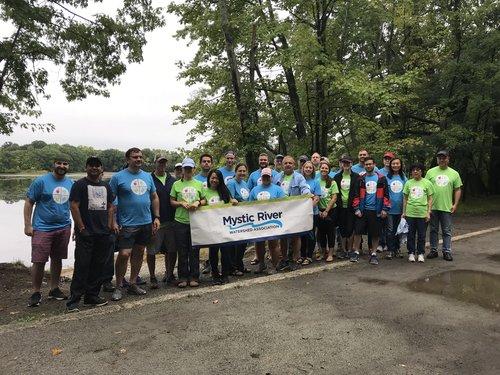Volunteers from Perkin Elmer helped remove water chestnuts in 2018.