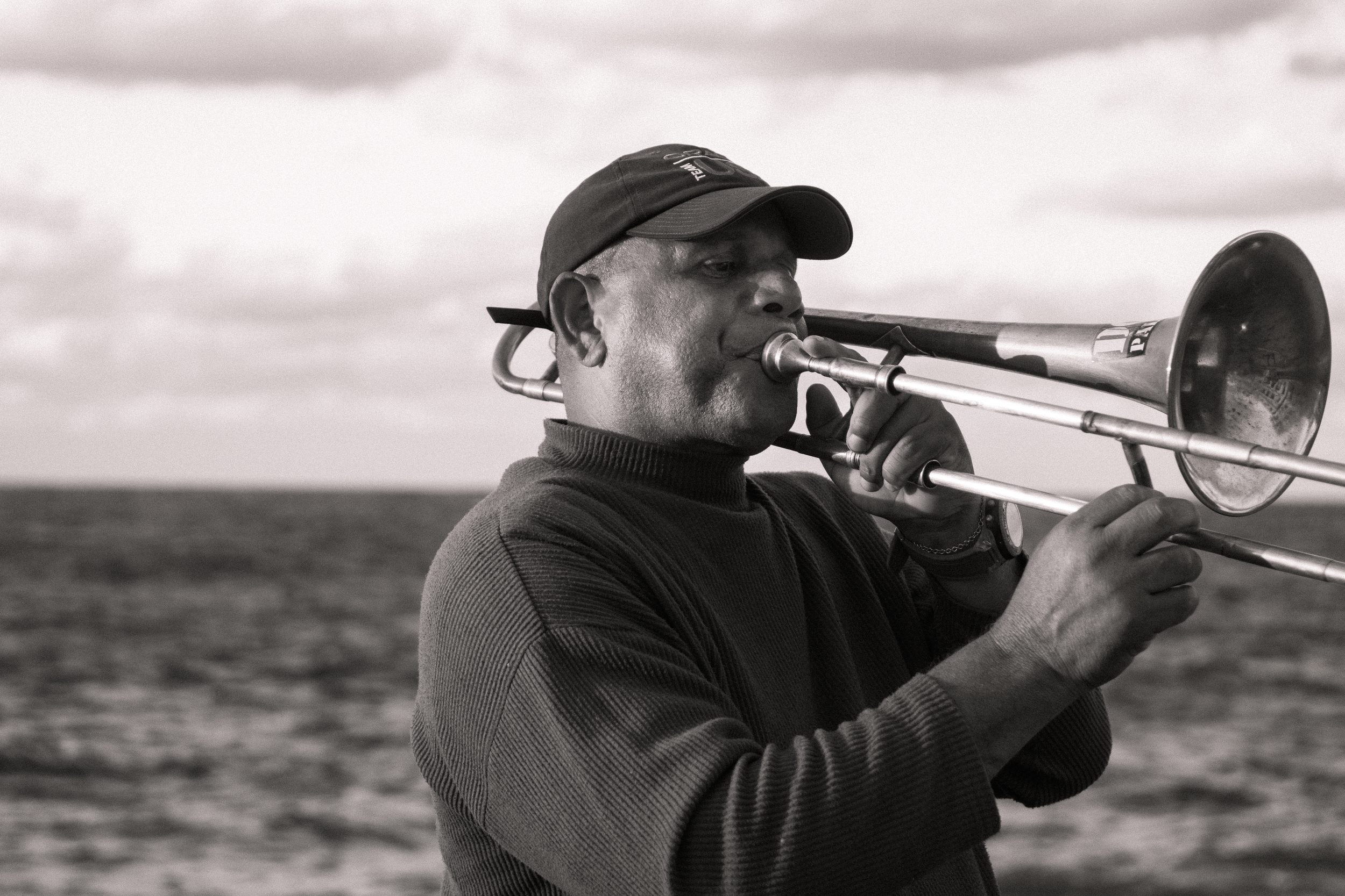ISO 200 / 55mm / f3.5 / 1/500sec -   On nice cool afternoons, the Malecon is full of tourists and local alike hanging along the seawall. Here is another trumpet player.