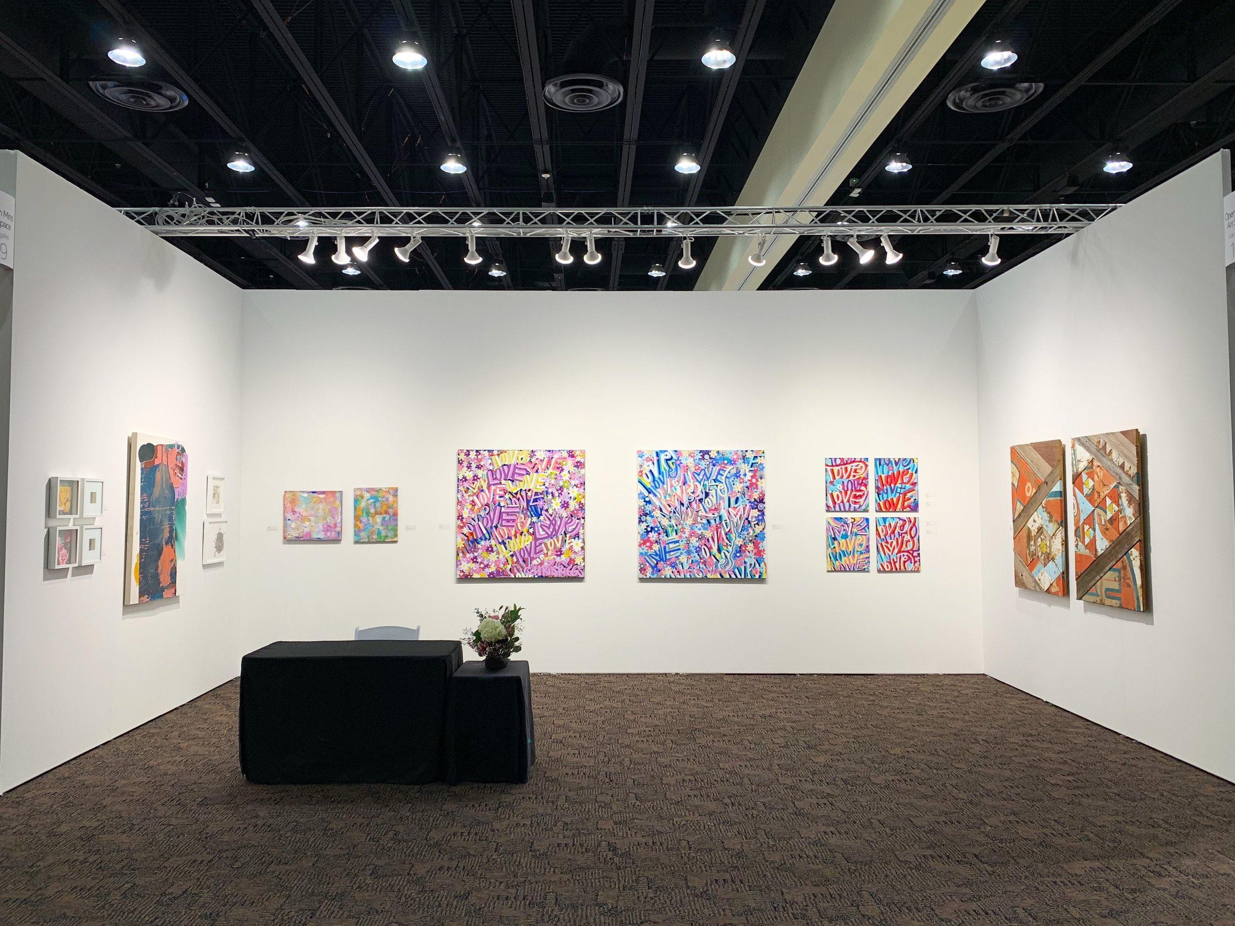 Installation view of Open Mind Art Space's fair booth at Art Palm Springs 2019