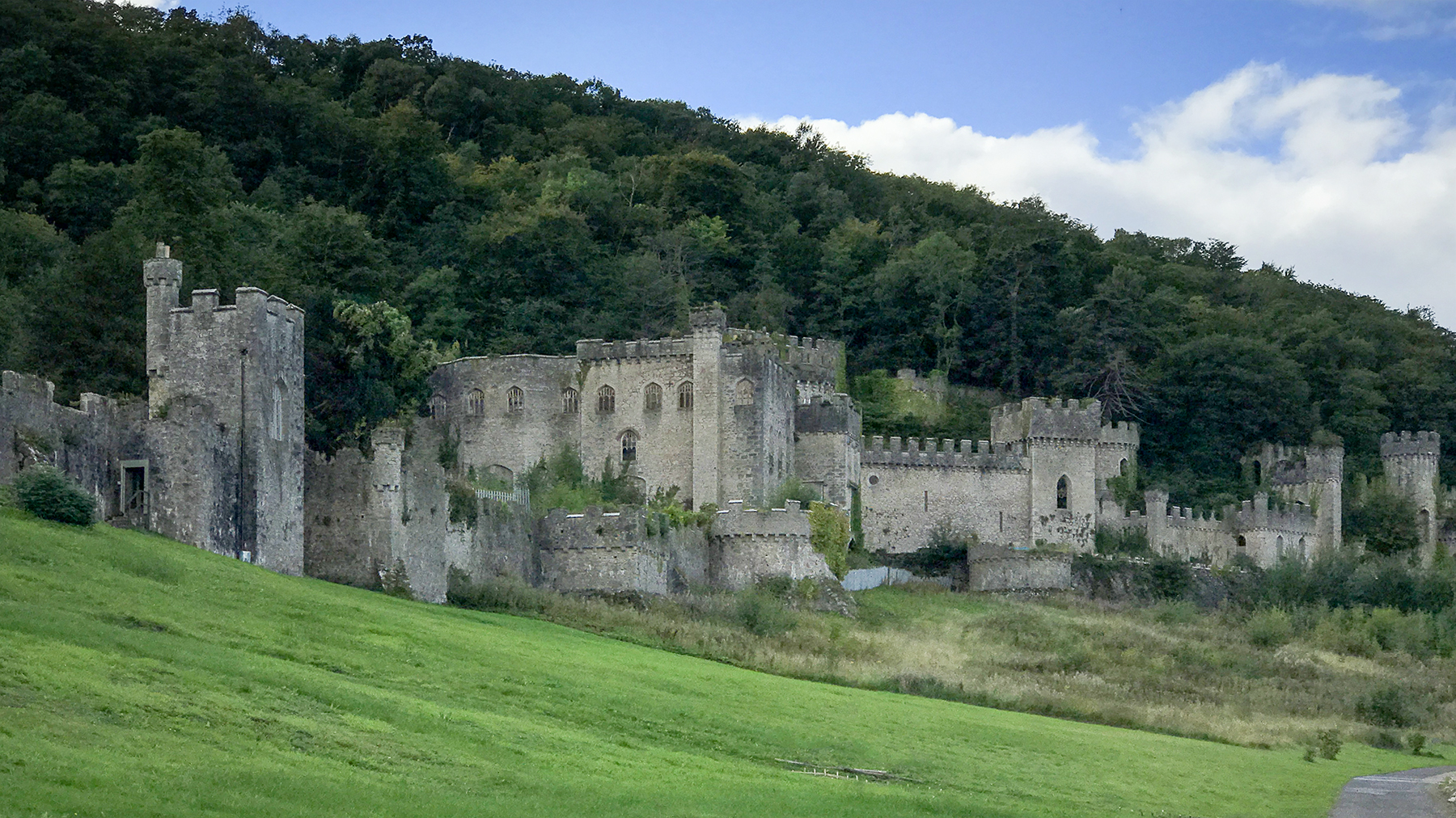 Gwyrch Castle is a Grade 1 listed building set in a wooded hillside overlooking the town of Abergele.