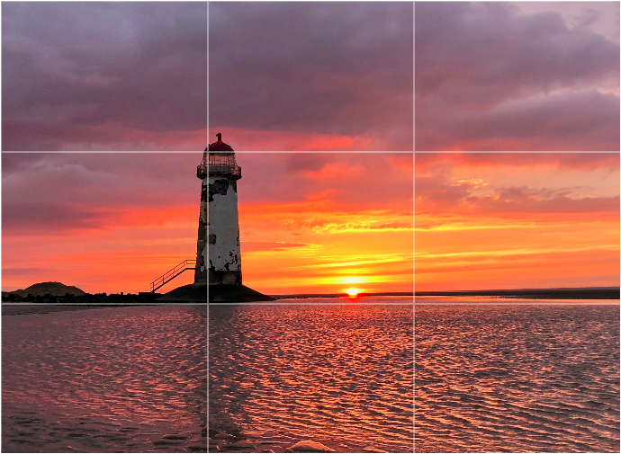 Lighthouse Sunset.  Compose your shot to emphasise the most interesting part of your subject. © Adrian McGarry.