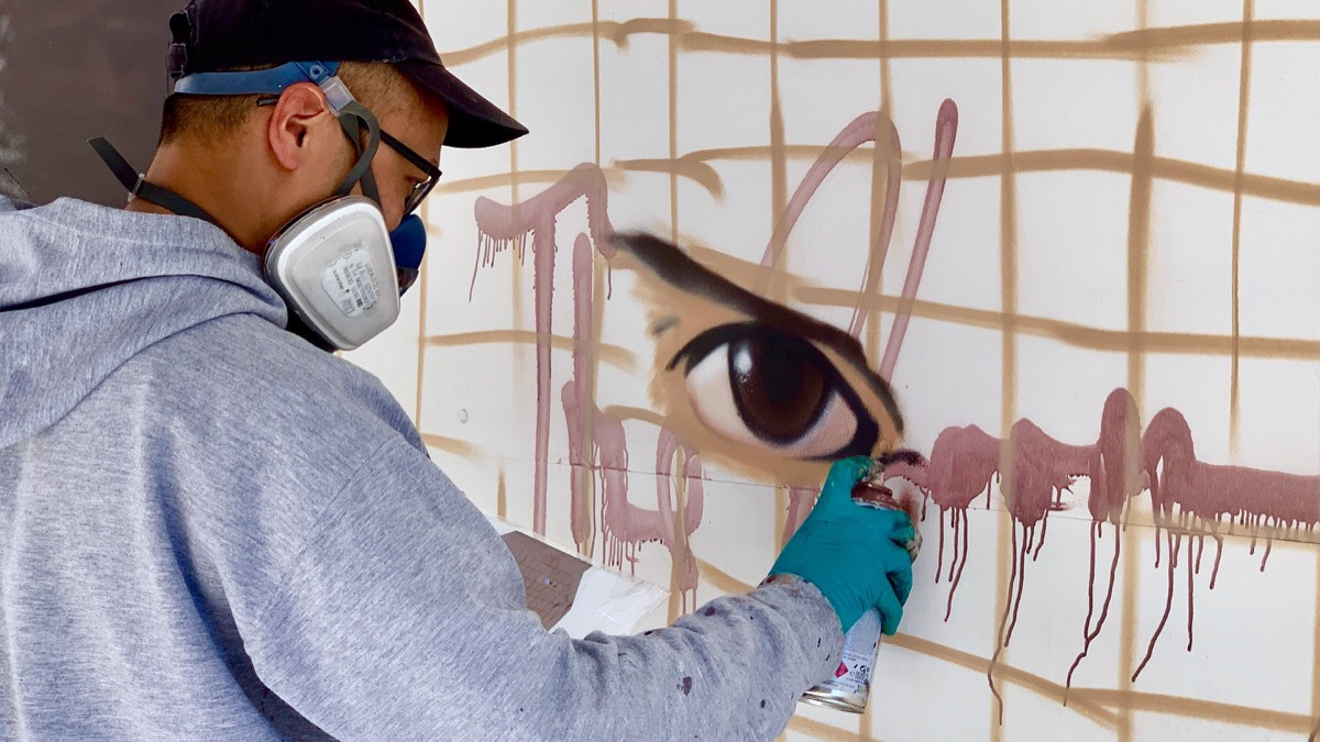 Legendary street artist Akse at work on the streets of Manchester's Northern Quarter.