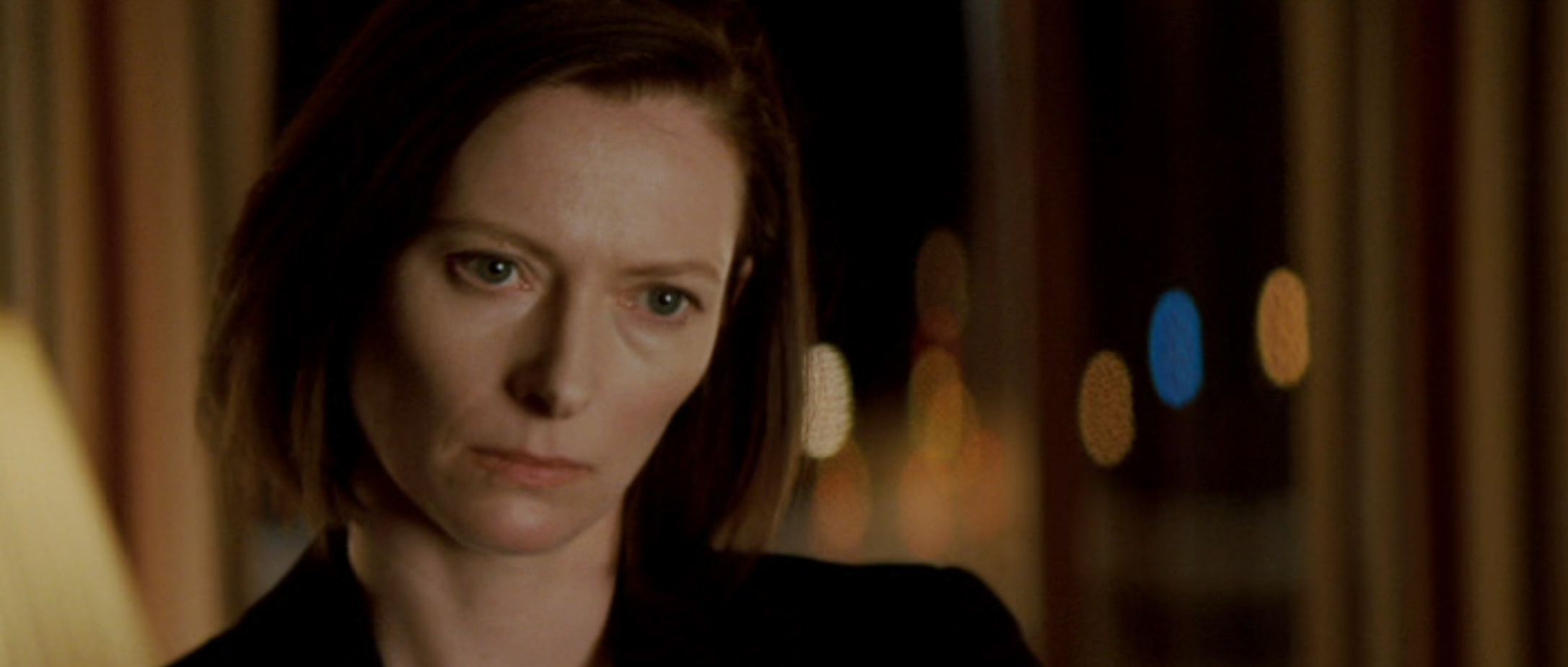 Karen (Swinton) decides how far she'll go to protect her company
