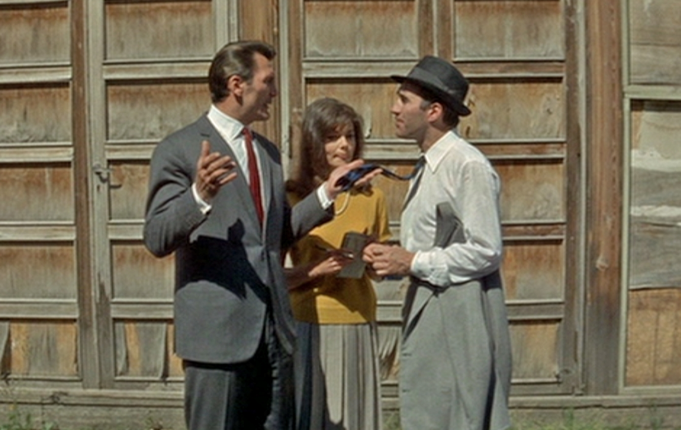 Piccoli is the fatally passive writer Paul Javal conversing with American film producer Prokosch (Jack Palance)