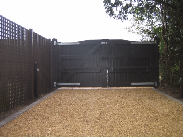 Gravel Driveway with Electric Wooden Gate