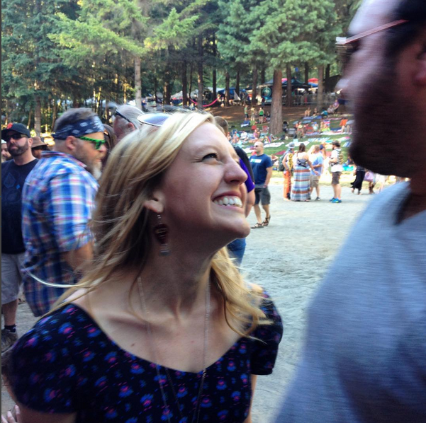 Her smile is contagious. I'll bet you're smiling just looking at this photo. :)