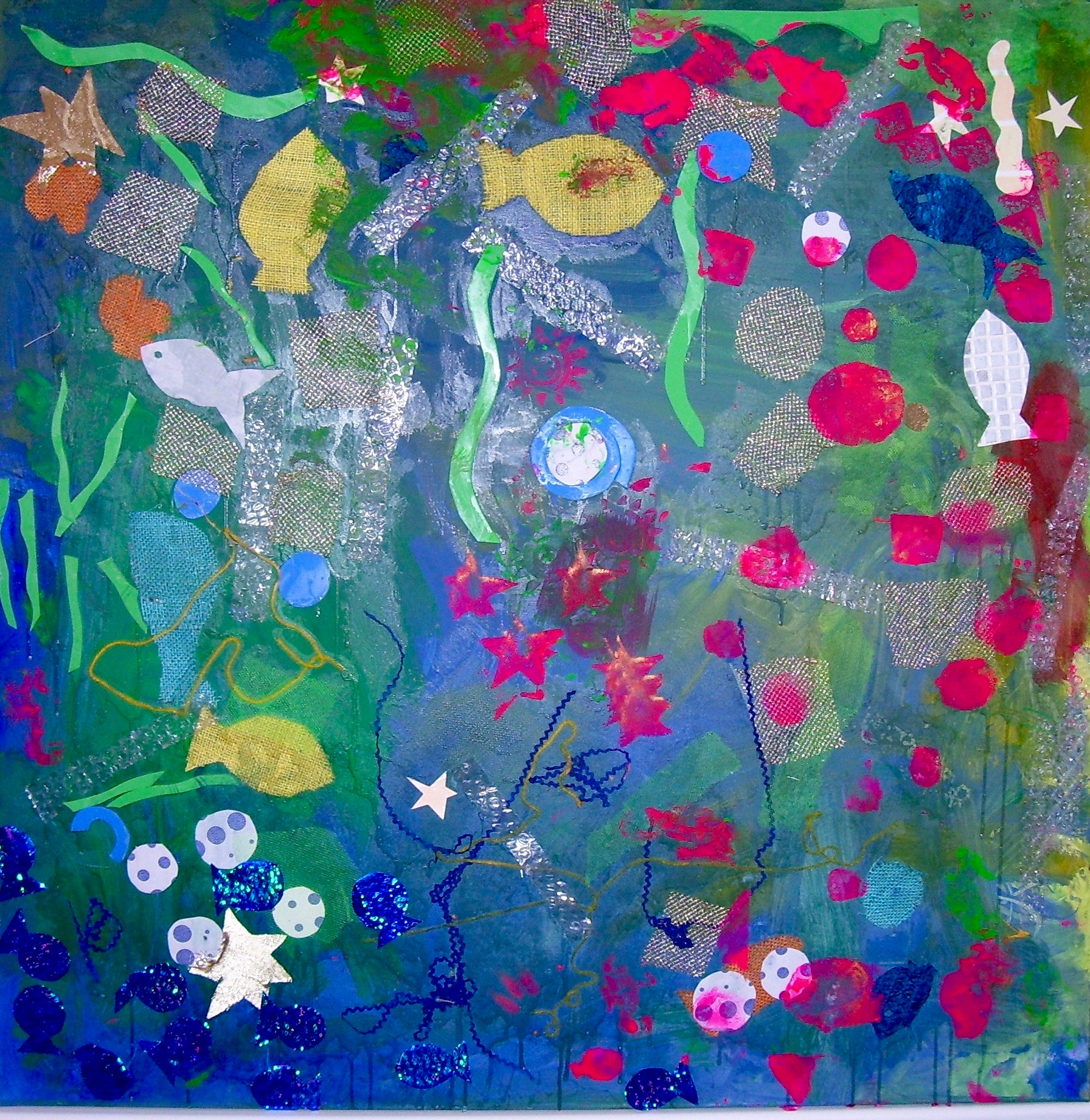 Collaged Canvas - Young pupils with complex needs enjoyed the tactile nature of the art materials used to create this 'Under the Sea' themed mixed media collage. They also explored mark making in different ways such as painting wet fabric and squeezing paint mixed with salt from bottles and watching it move and mix together.