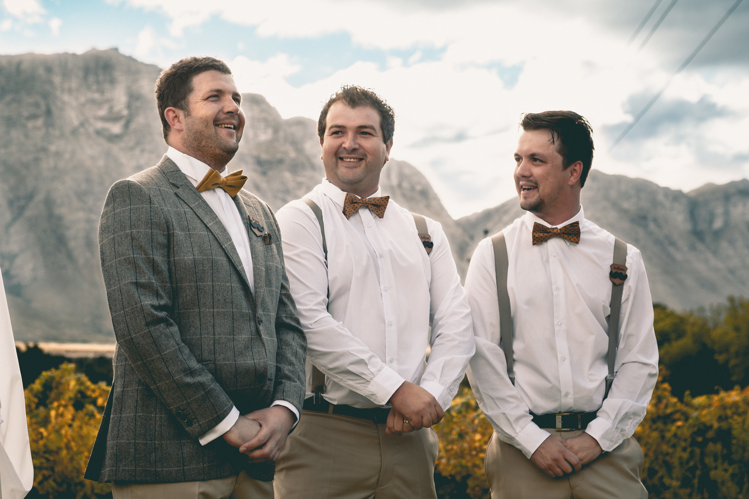 The Groom and his groomsmen wait for the bride at a beautiful autumn wedding in the countryside outside Cape Town, South Africa