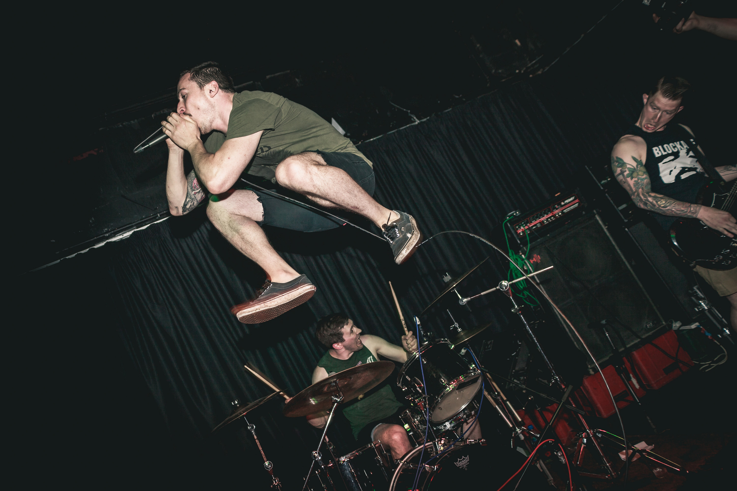 Vocalist Avi Kulawy leaps into the air while performing with Magrudergrind in London
