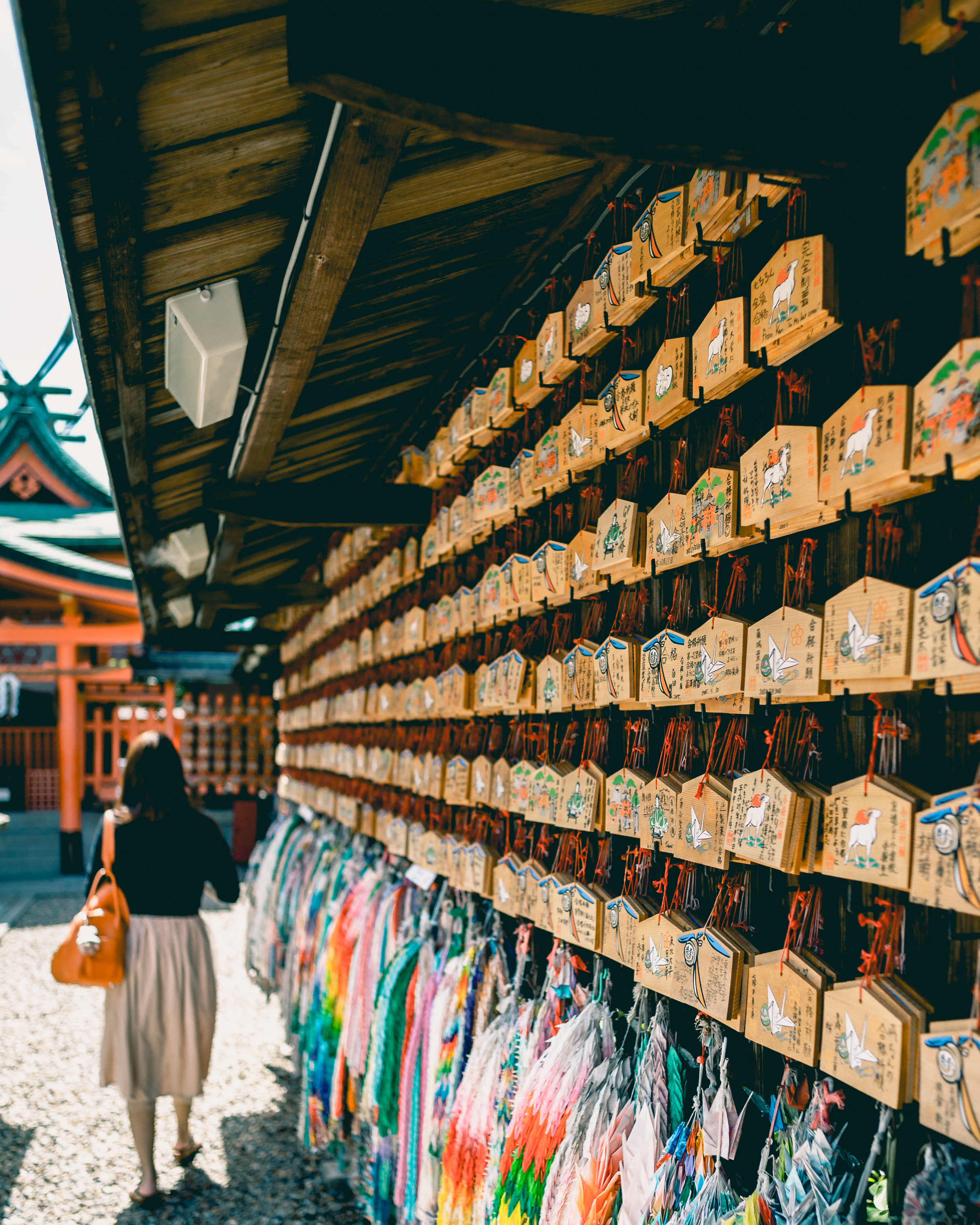"""""""Ema"""" (絵馬) hung up near a shrine at Fushimi Inari, Kyoto, Japan. These wooden plaques are hung by Shinto worshippers, detailing their prayers and wishes."""