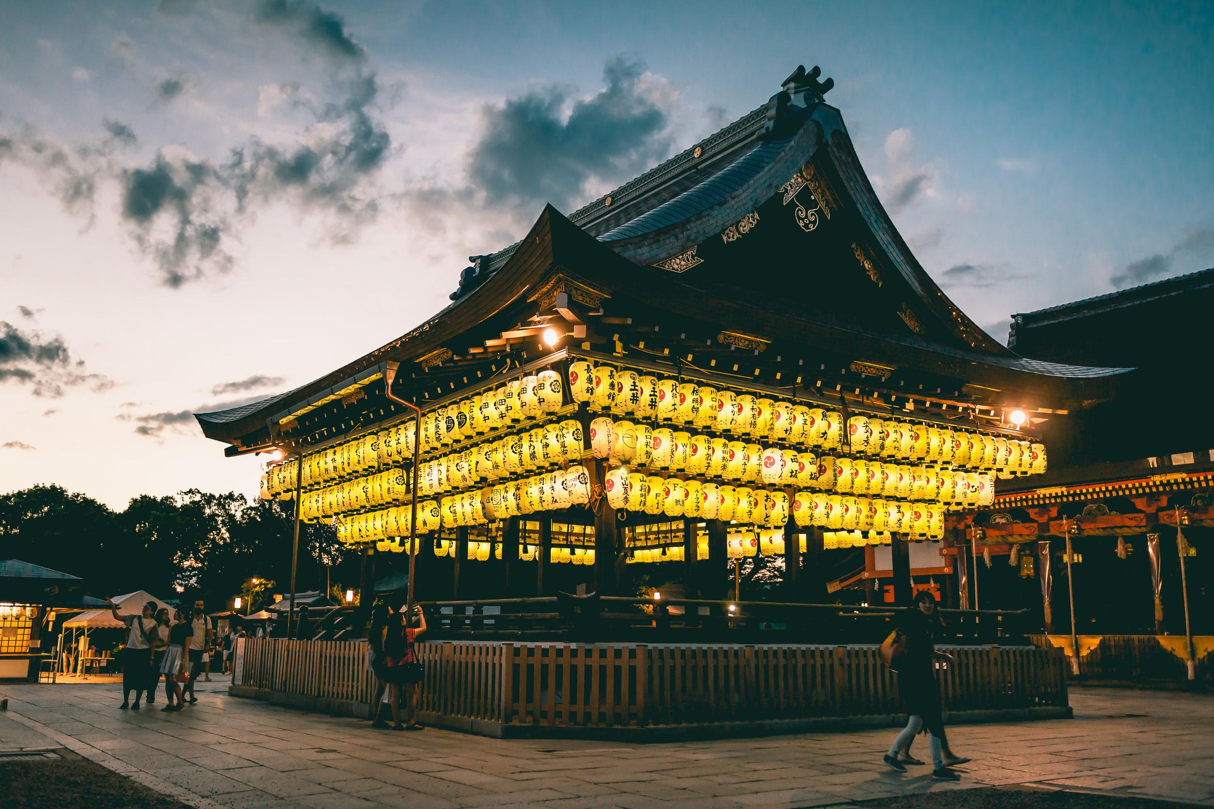 Paper lanterns lit up at sunset at Yasaka Shrine, Kyoto, Japan