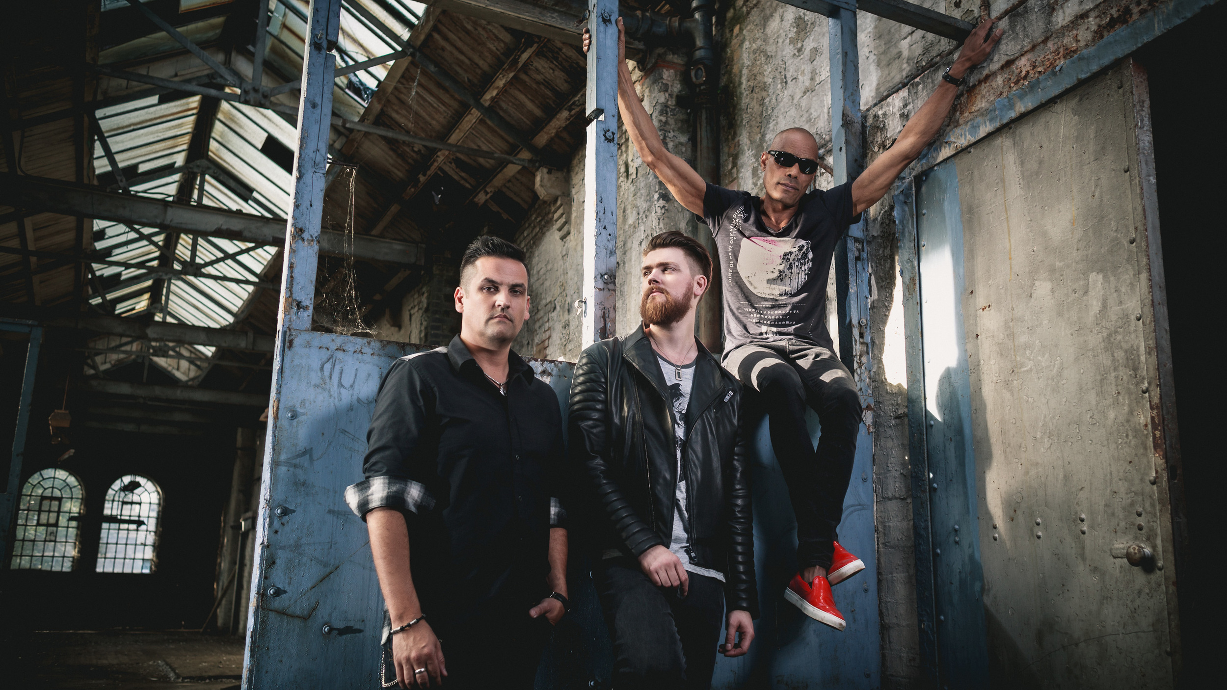 Band promo photo shoot for rock band Black Orchid Empire in abandoned industrial building in East London, UK