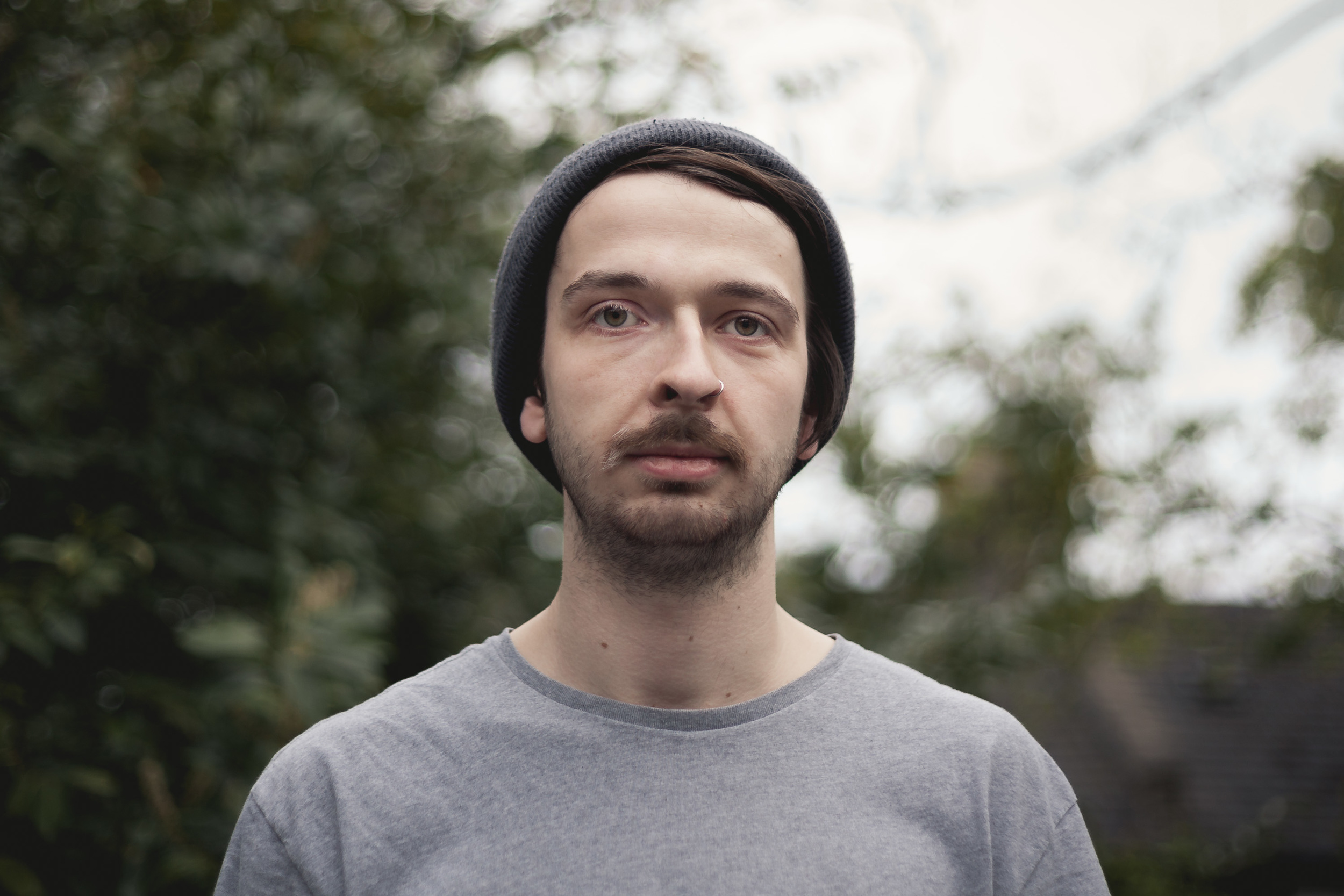 Headshot Portrait of Jacques Everiss, who runs Screamo label DONT CARE RECORDS