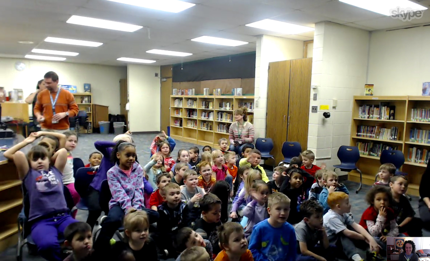 At the end of this session with kindergartners in Lapeer, MI , the teacher froze the screen so that all each student could stand up, turn around, and have a picture taken with me in the background. So sweet!