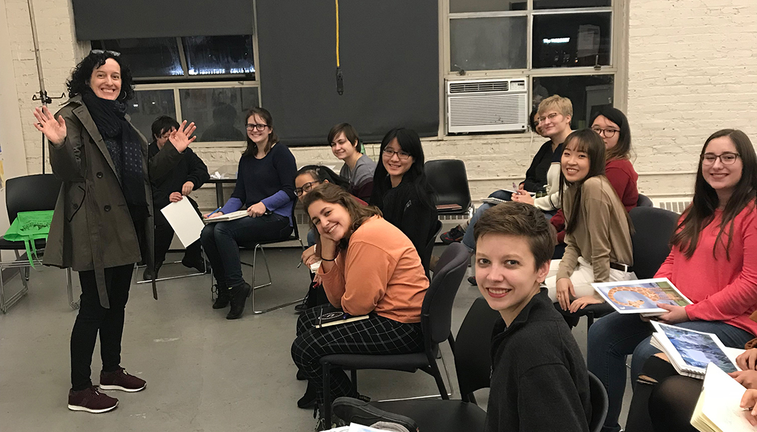 A presentation and critique for students in the undergraduate course on children's book illustration at MICA, Baltimore, Maryland.  (Photo courtesy of Shadra Strickland)