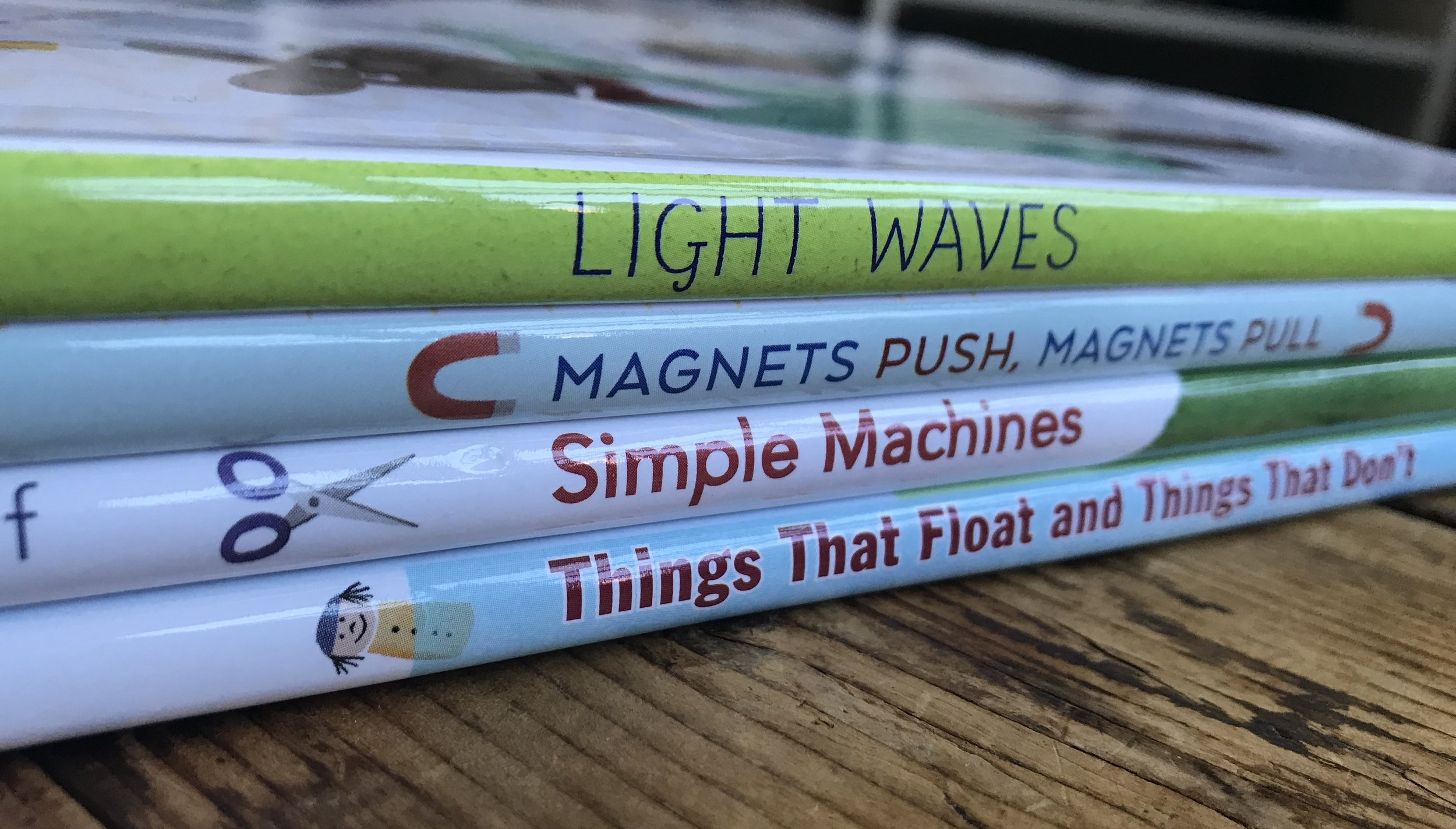 4 science book spines