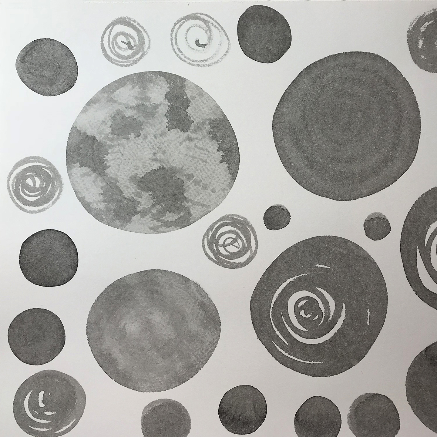 This was a common sight on my drawing board: some of the shapes painted in ink washes, soon to become planets.